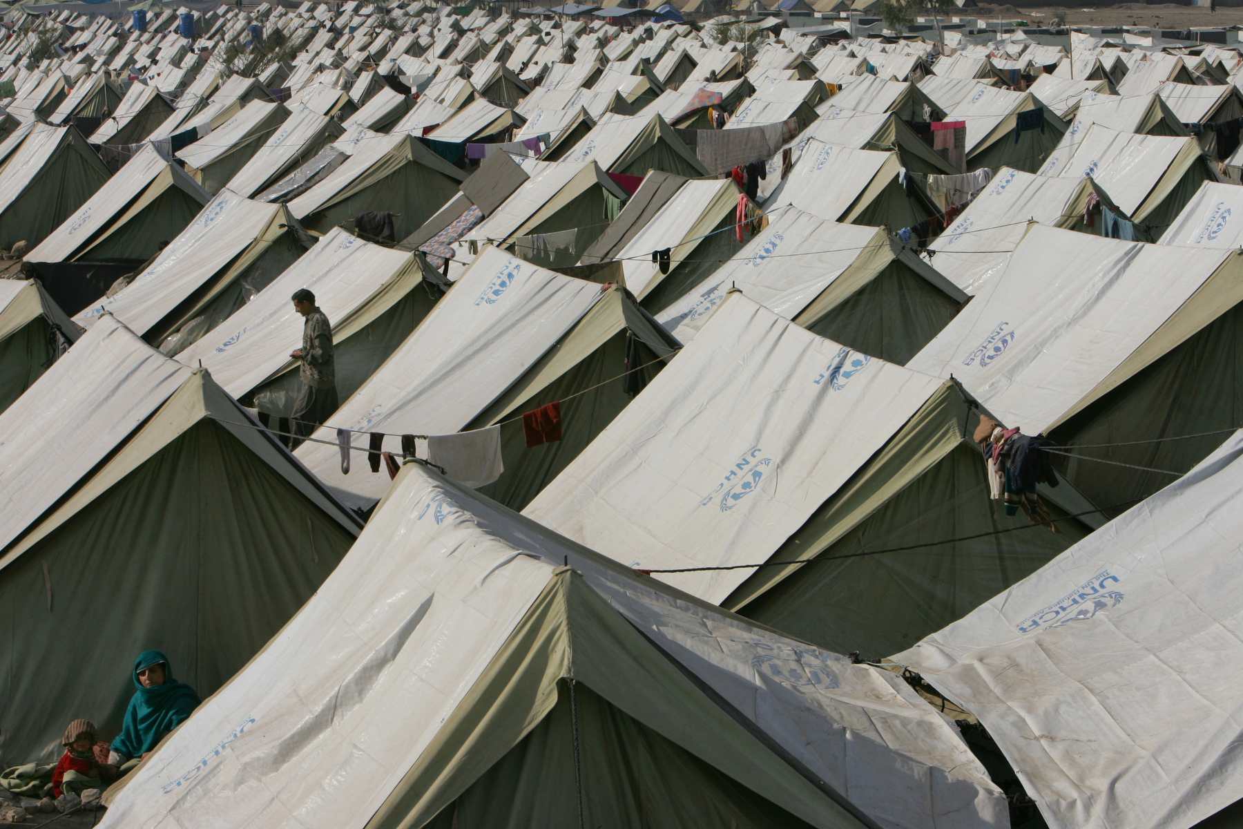 KASHTRA, PAKISTAN-DECEMBER 16: Earthquake survivors reside at a large tented camp in Kashtra, December 16, 2005. The camp has over 700 tents housing 3,336 earthquake victims who have moved from various area villages for the winter months.  Lack of snow is giving the quake survivors a break but they are still struggling in over crowded tented camps while fighting the cold weather with a lack of shelter.  (photo by Paula Bronstein /Getty Images)