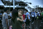 TACLOBAN, PHILIPPINES - NOVEMBER 12: Hundreds of victims of super typhoon Haiyan get evacuated waiting for a C130 aircraft to take them to Cebu in Tacloban, Philippines November 12, 2013. Four days after the typhoon devastated the region many have nothing left, they are without food or power and most lost their homes. An estimated 10,000 could have died from this horrific natural disaster.(Photo by Paula Bronstein/Getty Images)