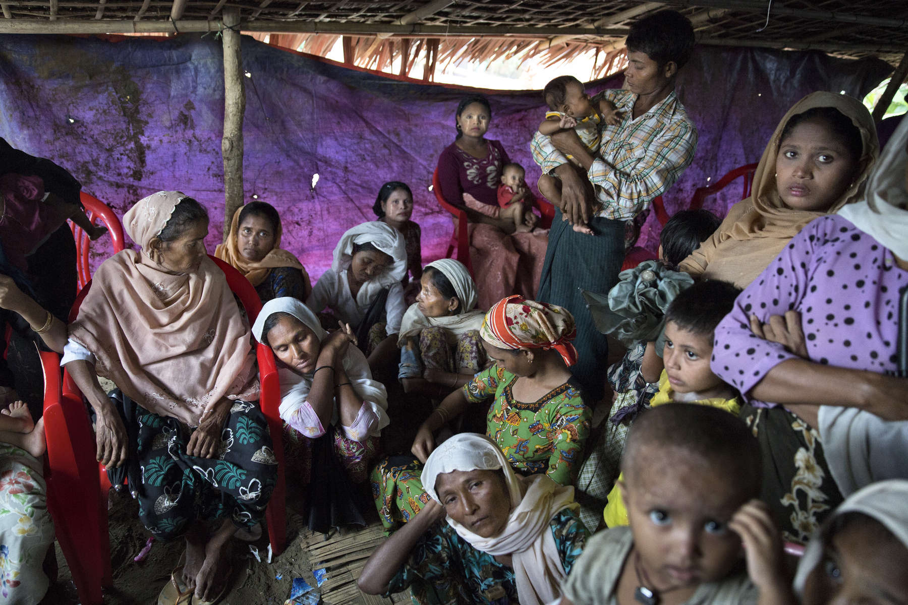 Women and children wait in line for medical care at the makeshift Aung Clinic which serves many Rohingya with a few dedicated staff giving free medical care. ( Photo by Paula Bronstein/ For The Washington Post )