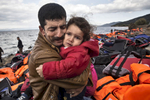 LESBOS, GREECE - OCTOBER 25: An Iraqi refugee cries as he holds his daughter after arriving safely to Lesbos from Turkey. Colder weather and rough seas continue to cause deaths at sea as thousands travel in overcrowded small rafts. According to the IOM, an estimated 100,000 people landed in Greece, an average of almost 4,500 per day in late October and November. Nearly all of those entering Greece on a boat from Turkey are from the war zones of Syria, Iraq and Afghanistan. (Photo by Paula Bronstein)