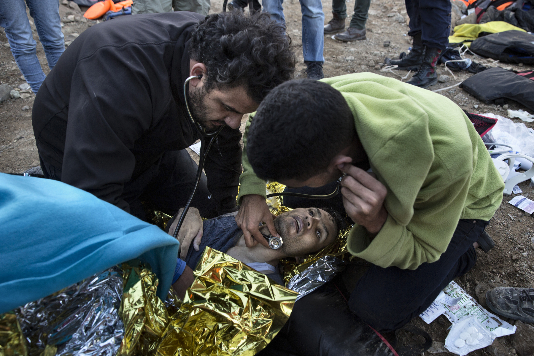 LESBOS, GREECE - OCTOBER 30: Israeli Doctor Essam Daod (left) gives CPR to a refugee who later died after being rescued from the open waters of the Aegean sea on the island of Lesbos, Greece on October 30, 2015. The man died despite the efforts of the lifeguards and medical personnel to revive him. Dozens of rafts and boats are still making the journey daily over 590,000 people have crossed into the gateway of Europe. Nearly all of those are from the war zones of Syria, Iraq and Afghanistan. (Photo by Paula Bronstein)