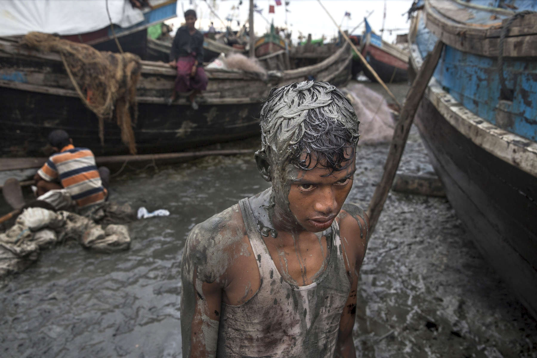 SITTWE - NOV 8: Mohammed Nur Amin takes a break from  working on an open wooden boat at the Ohn Taw Shi, a fishing village at the Rohingya IDP camp outside of Sittwe. Many Rohingya talk of fleeing, some want to go to the Malaysia.Paula Bronstein for The Washington Post