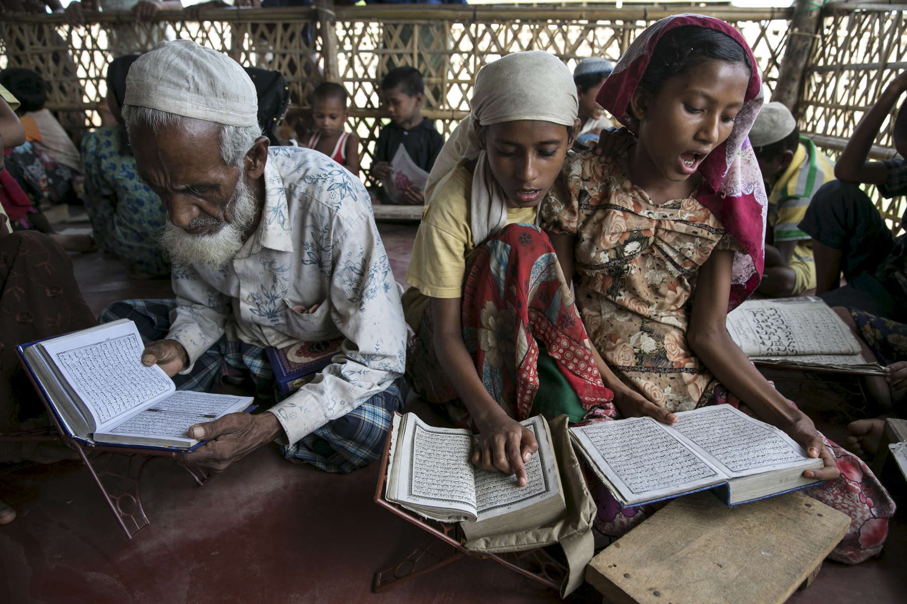 Rohingya girls study at a religious school teaching daily classes in Islamic studies at the Say Tha Mar Gyi IDP camp.( Photo by Paula Bronstein/ For The Washington Post )