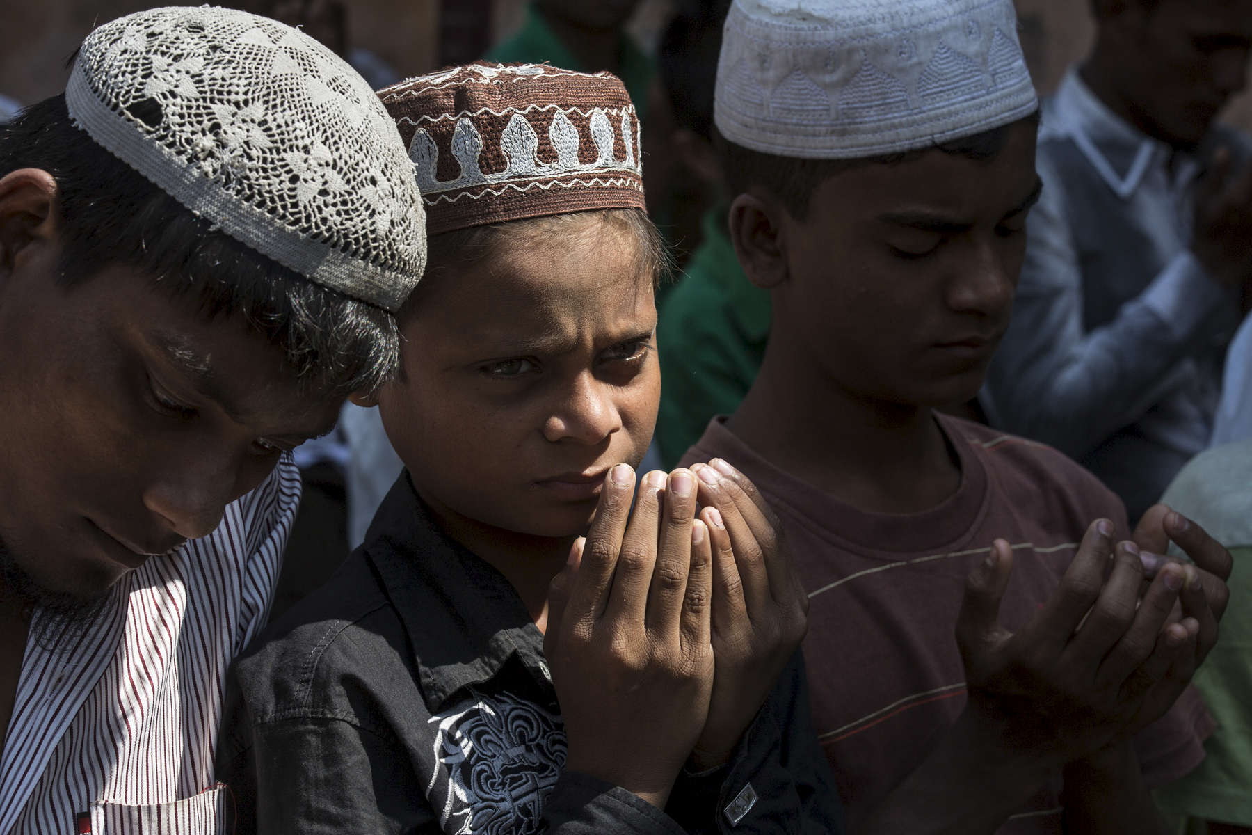 SITTWE - MARCH 6:  At a local mosque men and boys join in Friday prayer, a very important weekly practice for the Muslim Rohingya at the IDP camp. In 2012, sectarian violence between the Rohingya, who are Muslim and ethnic Rakhine Buddhists killed at least 200 people and made 140,000 homeless, most of them are Rohingya.