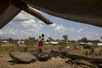 ADJUMANI DISTRICT-UGANDA: Pagarinya campRefugees are seen walking back to their tent after a prayer service. The Onward Struggle:  A refugee crisis in Uganda deepens as South Sudanese Refugees are forced to leave their country behind.The outbreak of violence in the capital Juba last July created a humanitarian crisis in northern Uganda as thousands of South Sudanese sought refugee there. The country is hosting the lion's share of South Sudanese refugees, with 373,626, more than a third of them arriving since early July.The fighting was a major setback to peace efforts in South Sudan, coming as the troubled new nation prepared to celebrate its fifth anniversary, amid a short lived peace deal between supporters of President Salva Kiir and former First Vice President Riek Machar. South Sudan now joins Syria, Afghanistan and Somalia as countries which have produced more than a million refugees. While some South Sudanese may attempt to head for Europe, the numbers within east Africa are comparable in scale to recent refugee flows to Europe from the Middle East, and their traumatic experiences due to war are often just as hellish. More than 85 percent of the refugees in this recent influx are women and children. Many children have lost one or both of their parents, some forced to become primary caregivers to siblings.With the large influx of refugees in July 2015, relief agencies had to implement stringent food rationing in the refugee settlements. Currently the international humanitarian organizations lack the necessary funds to meet the needs of the more than 200,000 refugees.