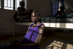 ADJUMANI DISTRICT-UGANDA:  At the Nyumanzi maternity clinic Maria Adol, age 20, deals with labor pains about to give birth to her first child. The Onward Struggle:  A refugee crisis in Uganda deepens as South Sudanese Refugees are forced to leave their country behind. The outbreak of violence in the capital Juba last July created a humanitarian crisis in northern Uganda as thousands of South Sudanese sought refugee there. The country is hosting the lion's share of South Sudanese refugees, with 373,626, more than a third of them arriving since early July.The fighting was a major setback to peace efforts in South Sudan, coming as the troubled new nation prepared to celebrate its fifth anniversary, amid a short lived peace deal between supporters of President Salva Kiir and former First Vice President Riek Machar. South Sudan now joins Syria, Afghanistan and Somalia as countries which have produced more than a million refugees. While some South Sudanese may attempt to head for Europe, the numbers within east Africa are comparable in scale to recent refugee flows to Europe from the Middle East, and their traumatic experiences due to war are often just as hellish. More than 85 percent of the refugees in this recent influx are women and children. Many children have lost one or both of their parents, some forced to become primary caregivers to siblings.With the large influx of refugees in July 2015, relief agencies had to implement stringent food rationing in the refugee settlements. Currently the international humanitarian organizations lack the necessary funds to meet the needs of the more than 200,000 refugees.