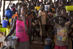 ADJUMANI DISTRICT-UGANDA: At the Nyumanzi transit camp refugees line up for hours to receive a hot meal from World Food Program (WFP) . The Onward Struggle:  A refugee crisis in Uganda deepens as South Sudanese Refugees are forced to leave their country behind. The outbreak of violence in the capital Juba last July created a humanitarian crisis in northern Uganda as thousands of South Sudanese sought refugee there. The country is hosting the lion's share of South Sudanese refugees, with 373,626, more than a third of them arriving since early July.The fighting was a major setback to peace efforts in South Sudan, coming as the troubled new nation prepared to celebrate its fifth anniversary, amid a short lived peace deal between supporters of President Salva Kiir and former First Vice President Riek Machar. South Sudan now joins Syria, Afghanistan and Somalia as countries which have produced more than a million refugees. While some South Sudanese may attempt to head for Europe, the numbers within east Africa are comparable in scale to recent refugee flows to Europe from the Middle East, and their traumatic experiences due to war are often just as hellish. More than 85 percent of the refugees in this recent influx are women and children. Many children have lost one or both of their parents, some forced to become primary caregivers to siblings.With the large influx of refugees in July 2015, relief agencies had to implement stringent food rationing in the refugee settlements. Currently the international humanitarian organizations lack the necessary funds to meet the needs of the more than 200,000 refugees.