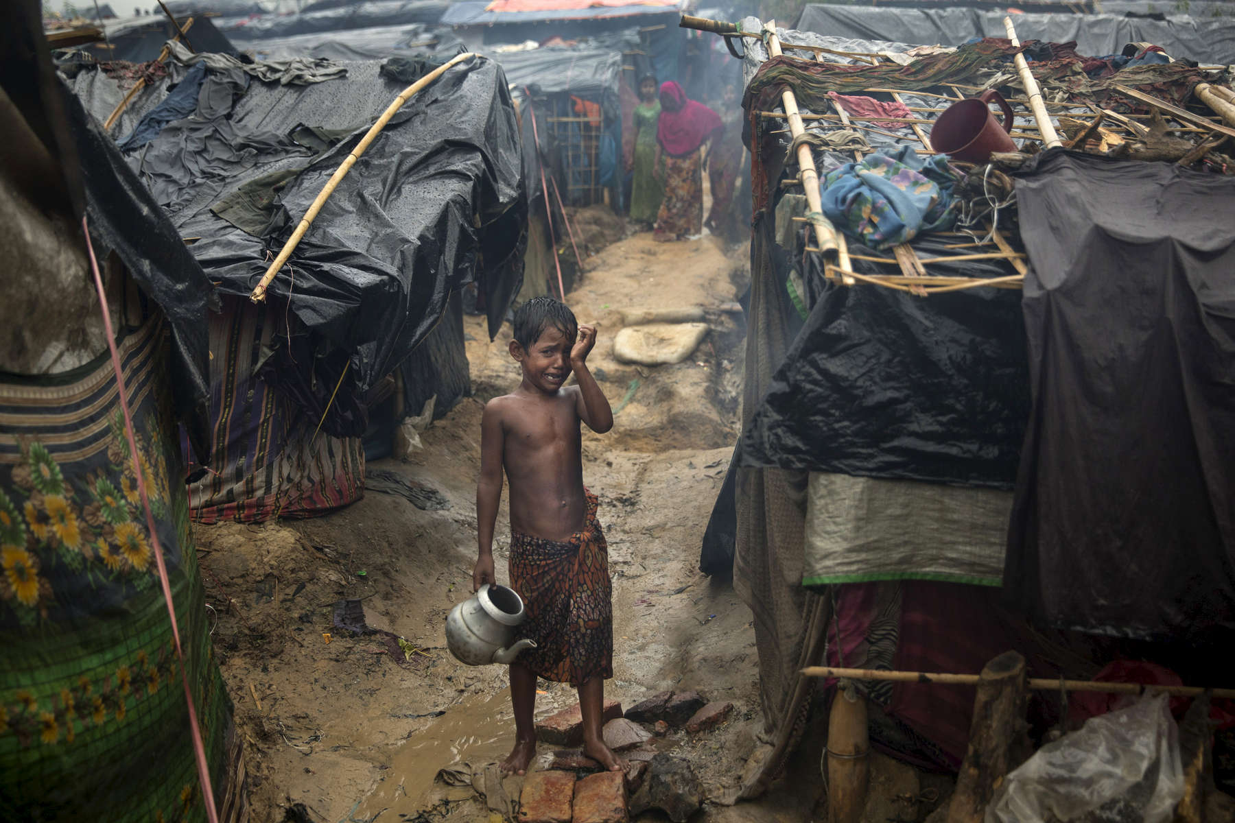 THAINKHALI, BANGLADESH - OCTOBER 7: A Rohingya boy cries as monsoon rains continue to batter the area causing more difficulties October 7, Thainkhali camp, Cox's Bazar, Bangladesh. e.