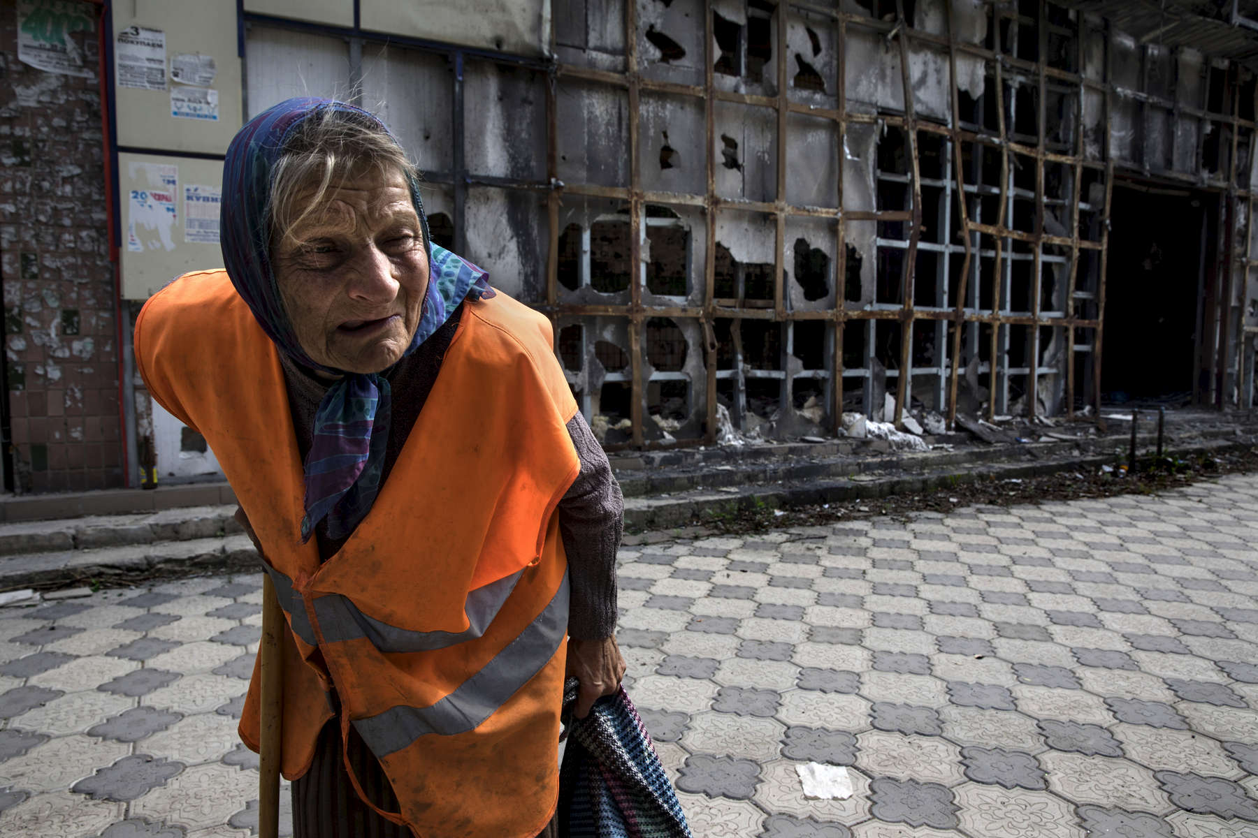 "Raisa Andreyevna,72, walks home from a local market area which was destroyed back in 2015. She works as a janitor which pays her enough to survive. Originally from Russia, she now lives alone. Her children and grandchildren have all moved away to safer areas as part of Donetsk remain dangerous and occasionally gets shelled. ""I have told them to move out, I am not afraid to get killed because I have already lived my life but they have children they have to take care of."" Since the beginning of the war she can no longer receive her Ukrainian pension of $50 a month. After more than four years of war the armed conflict in eastern Ukraine has a human toll that is staggering. The war has displaced more than 1.6 million with over 2,500 civilians killed and 9,000 injured. Some 200,000 people live under constant fear of shelling every day, with nearly a third of the 3.4 million people in need of humanitarian assistance over 60 years of age. Ukraine has the highest proportion of elderly affected by war in the world."
