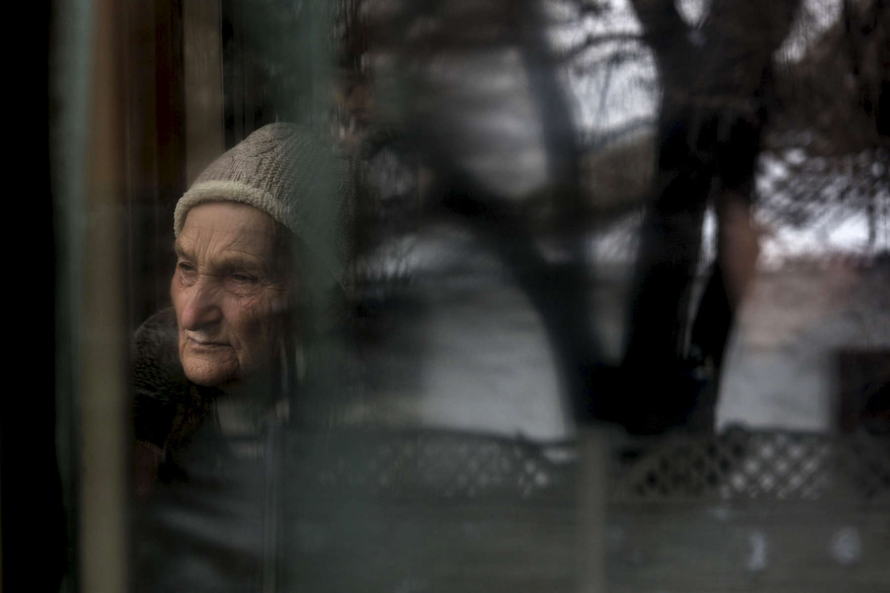 An elderly woman is seen reflected in the window of a streetcar in Donetsk.After more than four years of war the armed conflict in eastern Ukraine has a human toll that is staggering. The war has displaced more than 1.6 million with over 2,500 civilians killed and 9,000 injured. Some 200,000 people live under constant fear of shelling every day, with nearly a third of the 3.4 million people in need of humanitarian assistance over 60 years of age. Ukraine has the highest proportion of elderly affected by war in the world.