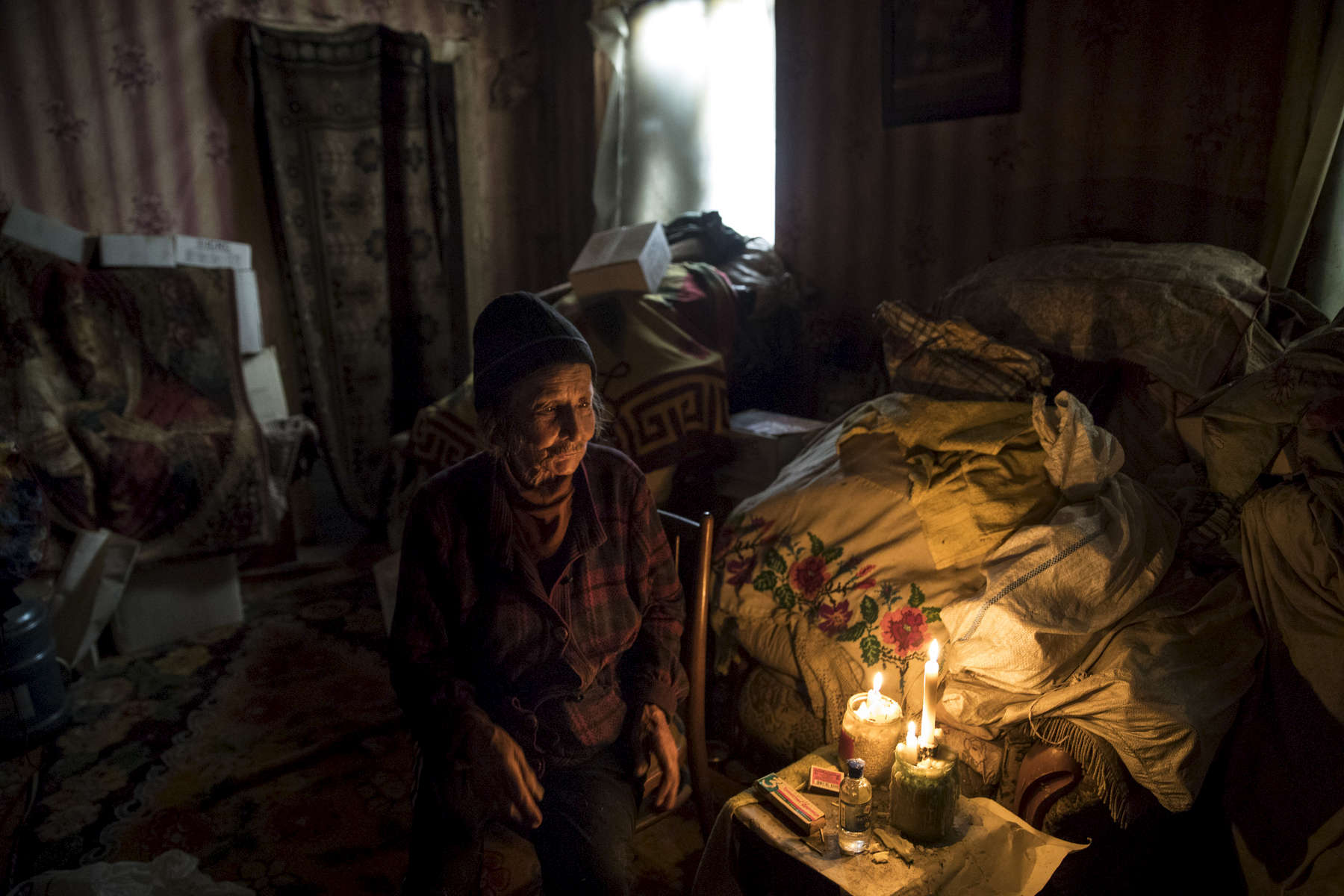 Opytne' Eastern Ukraine:  Mariya Gorpynych, age 76, lives alone. She speaks with tears in her eyes while talking about the death of her son. Victor,48 was killed due to the war in 2016, he was fatally injured by shelling that hit the home. He died in her hands. Her husband, died in the same year from a heart attack  from extreme stress of living too close to the front line. Mariya refuses to leave her village because her family are buried there.{quote}I have nowhere to flee, my whole family is buried here.{quote}  {quote}I got used to the continued shelling.{quote} Opytne is a war torn village on the contact line where only 43 people are left due to the dangers.