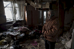 Donetsk,  Donetsk People's Republic (DPR):Antonina Kondratiyevna, 77, stands in her neighbor's home, destroyed during heavy battles between Ukrainian army and pro-Russian militia in 2014-2015. She and her elderly sister are among few residents living in the devastated neighborhood near Donetsk airport.After more than four years of war the armed conflict in eastern Ukraine has a human toll that is staggering. The war has displaced more than 1.6 million with over 2,500 civilians killed and 9,000 injured. Some 200,000 people live under constant fear of shelling every day, with nearly a third of the 3.4 million people in need of humanitarian assistance over 60 years of age. Ukraine has the highest proportion of elderly affected by war in the world.