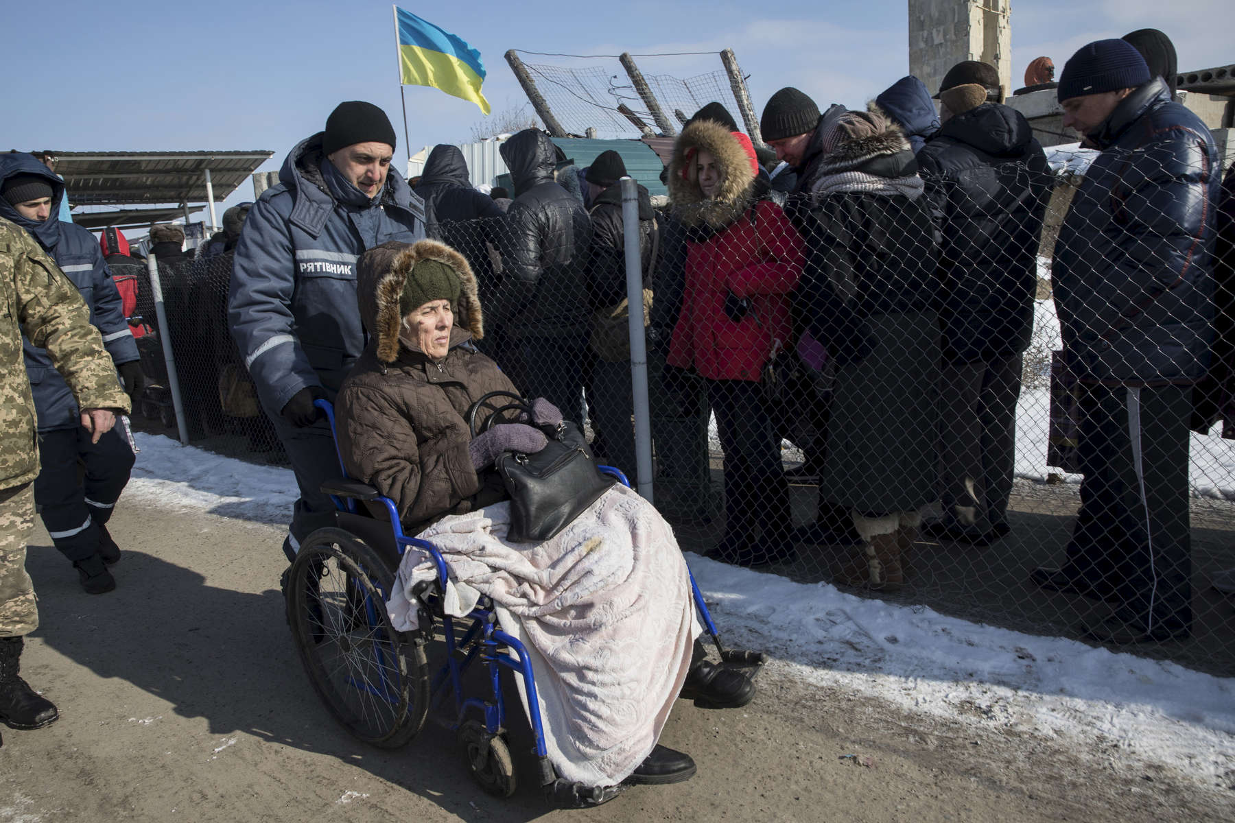 Luhansk,Eastern Ukraine: An elderly woman gets help via a wheelchair as she crosses into the border area from Eastern Ukraine to Luhansk, for many this is a real burden making the journey to collect their pension.After more than four years of war the armed conflict in eastern Ukraine has a human toll that is staggering. The war has displaced more than 1.6 million with over 2,500 civilians killed and 9,000 injured. Some 200,000 people live under constant fear of shelling every day, with nearly a third of the 3.4 million people in need of humanitarian assistance over 60 years of age. Ukraine has the highest proportion of elderly affected by war in the world.