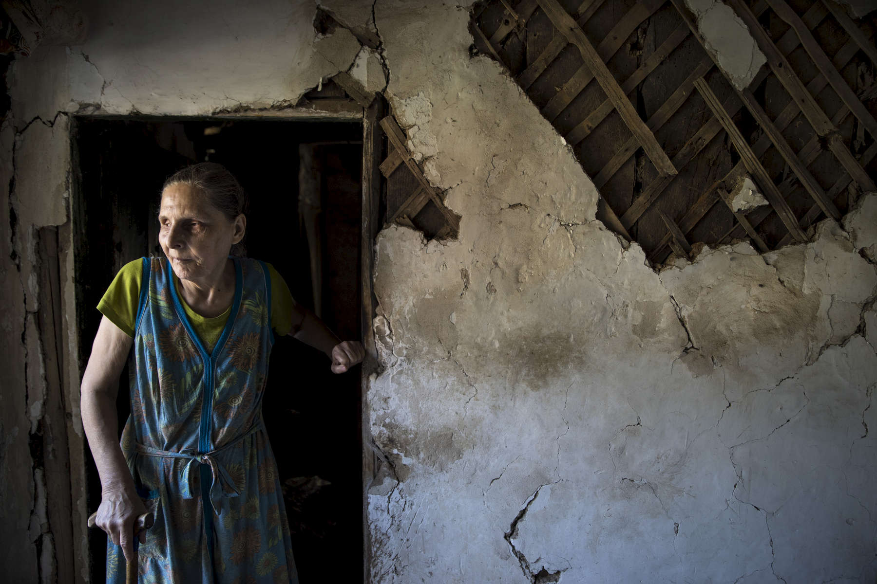Avdiivika: Elena Parshyna,age 66, is blind and lives alone,feeling depressed and lonely after her husband had a heart attack in April. Her son also died late in 2017 from the same fate. To make matter worse, Both were buried in a small cemetery that is mined and now too close to the military positions so she never can go visit the graves. The home was shelled last year, still damaged but Elena refuses to leave. Her remaining family - daughter and a sister all live on the other side of the contact line in Makeyevka city controlled by pro-Russian separatists.