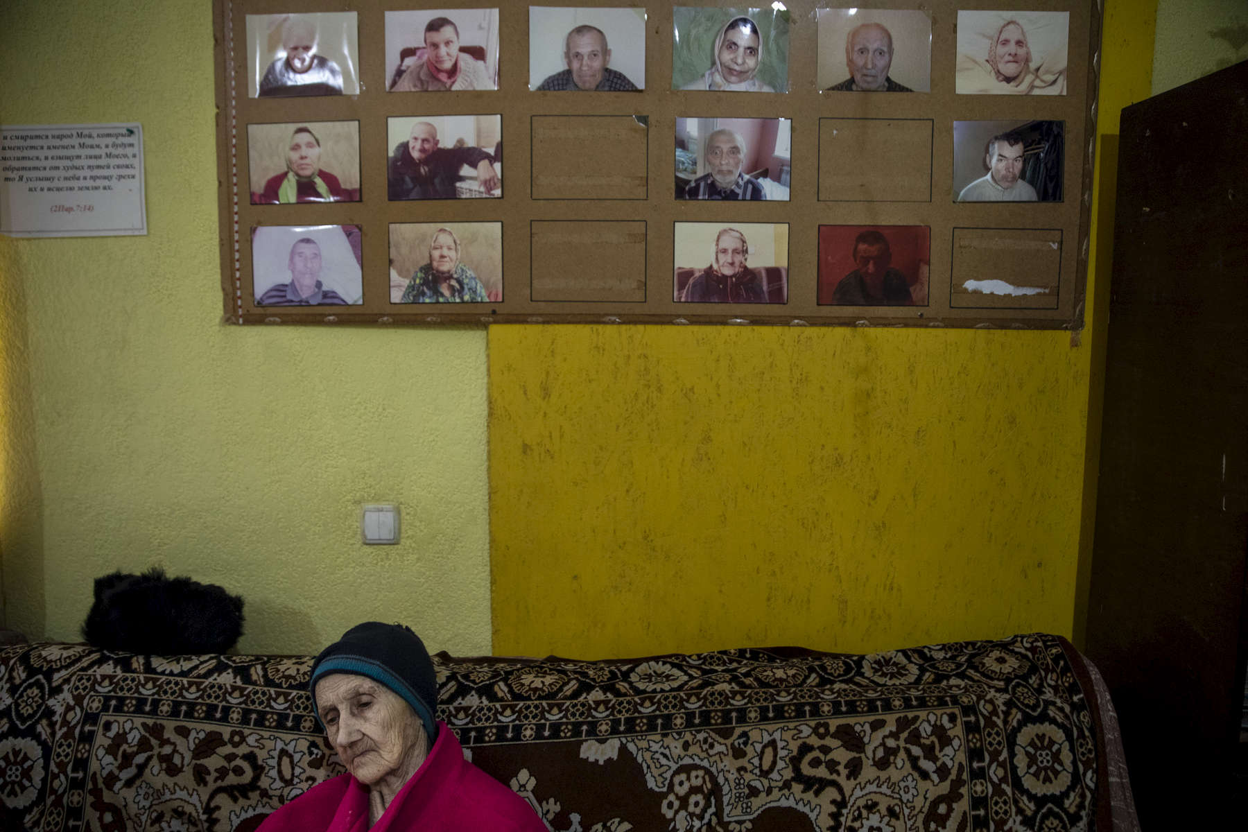 Druzhkovka Nursing home - Donetsk region:Lidiya Nikitichna, 78, rests on a sofa. Photographs of residents are seen, as they pass away their photo is taken off the wall. The nursing home facility takes care of many elderly who are left behind, and poverty stricken due to the war. After more than four years of war the armed conflict in eastern Ukraine has a human toll that is staggering. The war has displaced more than 1.6 million with over 2,500 civilians killed and 9,000 injured. Some 200,000 people live under constant fear of shelling every day, with nearly a third of the 3.4 million people in need of humanitarian assistance over 60 years of age. Ukraine has the highest proportion of elderly affected by war in the world.