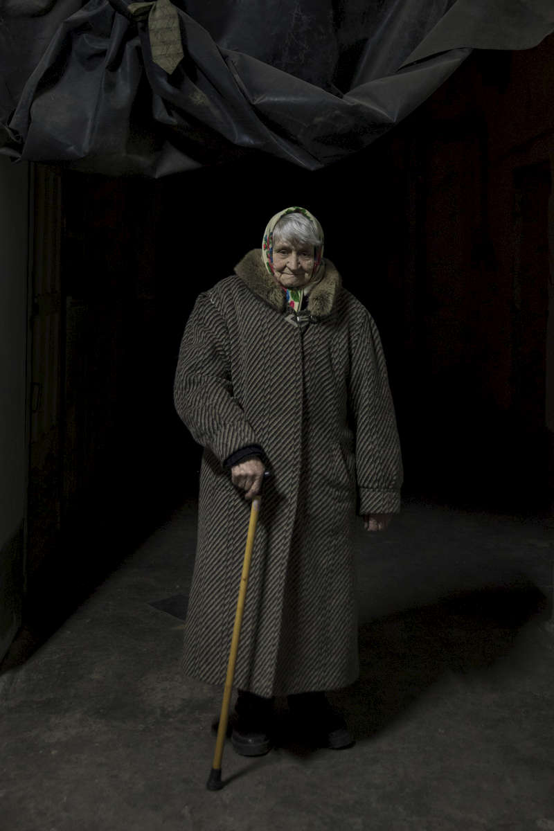 "Vera Alekseyevna, age 78 is without any real family support after she lost her son and her husband last year, she has been living in the bomb shelter since 2014. Her heath has deteriorated with high blood pressure and a weak heart. Her house is close to the contact line and she is afraid to stay in her apartment on the 5th floor.""I am afraid that I need to run from the fifth floor if the shelling starts.""  ""If there is no shelling, I run home to take a shower.""""It would be much easier if I received both Ukrainian and DPR pension. But I receive only local one."" She gets 3000 rubles a month. Petrovsky district of Donetsk: The bunker ( bomb shelter) houses on average 6-8 people, mostly elderly women who say they can't go back to their homes as the contact line lays just few kilometers away from the bomb shelter that used to belong to an old coal mine. In 2014, there were 300 people living there during the height of the war. After more than four years of war the armed conflict in eastern Ukraine has a human toll that is staggering. The war has displaced more than 1.6 million with over 2,500 civilians killed and 9,000 injured. Some 200,000 people live under constant fear of shelling every day, with nearly a third of the 3.4 million people in need of humanitarian assistance over 60 years of age. Ukraine has the highest proportion of elderly affected by war in the world."