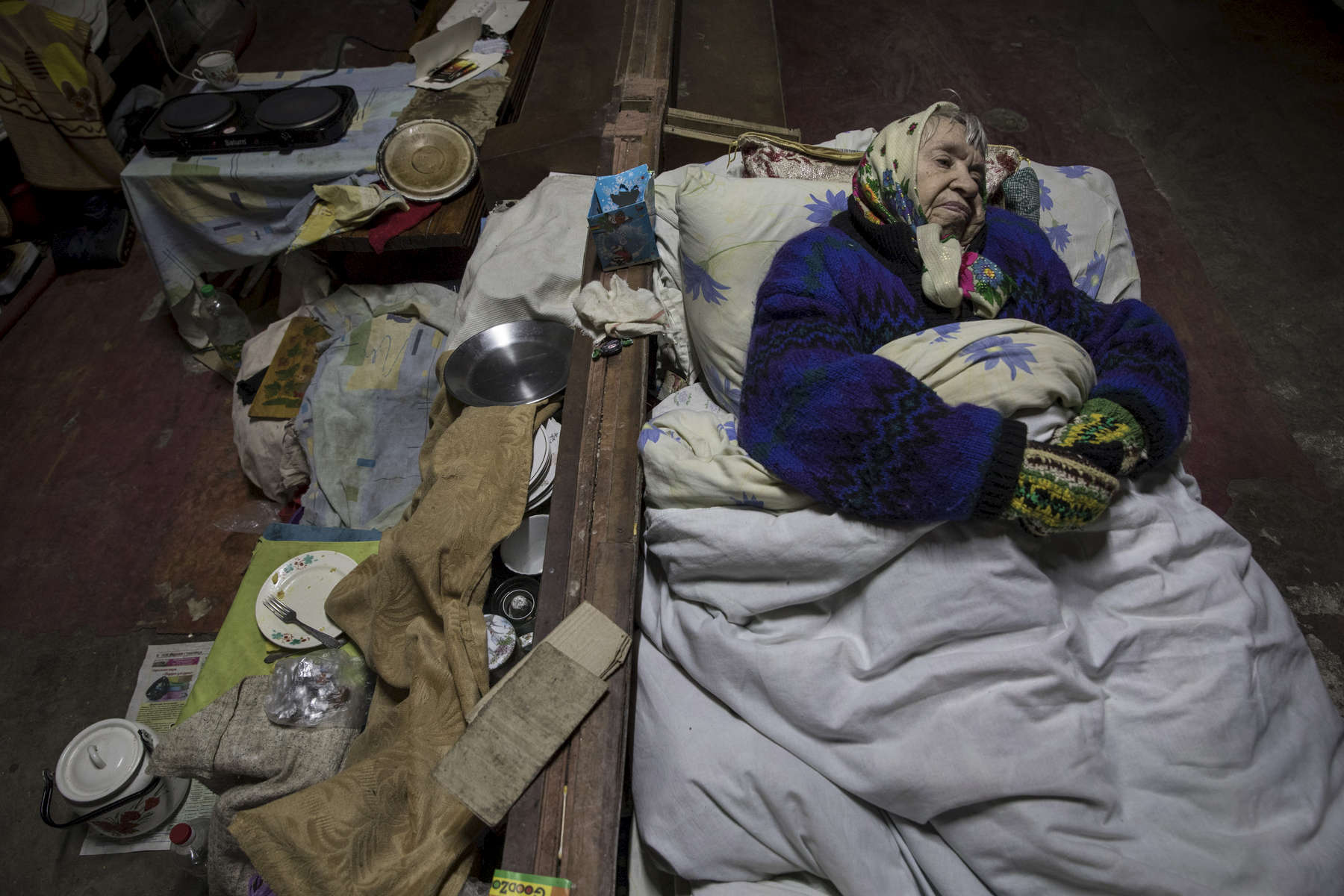 "Mariya Ivanovna, age 85 has been living in a bomb shelter for 4 years. Her pension is the only source of income for the whole family. She has suffered two strokes. ""I remember the WW2. There is no difference between these two wars. Back then we had nothing to eat and nowhere to hide.""""It's very difficult to call an ambulance. They don't come because of the shelling.""After more than four years of war the armed conflict in eastern Ukraine has a human toll that is staggering. The war has displaced more than 1.6 million with over 2,500 civilians killed and 9,000 injured. Some 200,000 people live under constant fear of shelling every day, with nearly a third of the 3.4 million people in need of humanitarian assistance over 60 years of age. Ukraine has the highest proportion of elderly affected by war in the world."