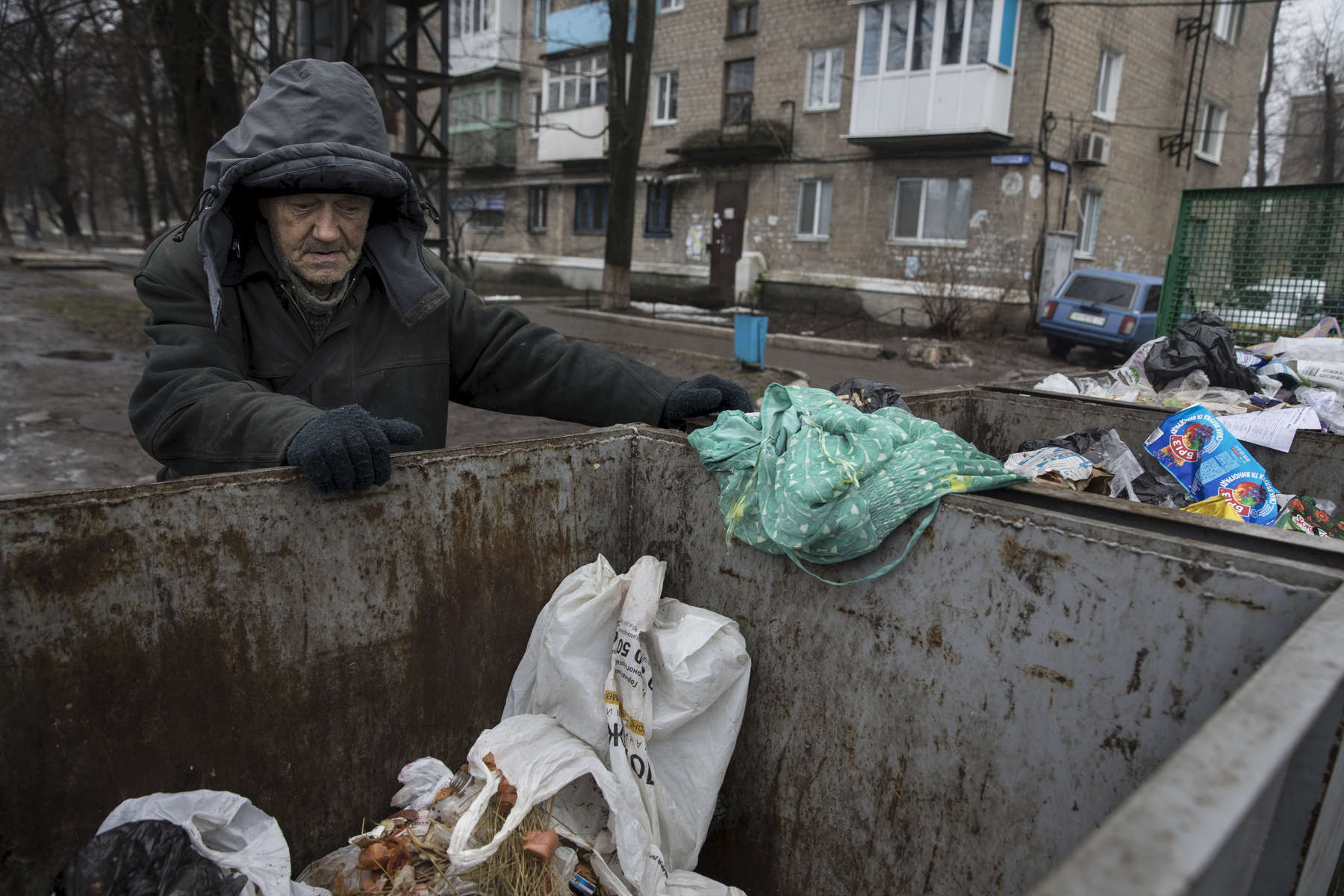 Avdiivka, Eastern Ukraine: Nikolay age 61, is homeless, his house was destroyed in old Avdiivka. He collects garbage for recycling to earn a few dollars and sleeps in a bunker underground in one of the apartment blocks in the city. He barely survives, has lost his passport, and has no money for medicine, unable to receive a pension after his documents were destroyed in the fire.  Over the winter he got frostbite in his feet causing an infection that won't go away, he suffers in constant pain. After more than four years of war the armed conflict in eastern Ukraine has a human toll that is staggering. The war has displaced more than 1.6 million with over 2,500 civilians killed and 9,000 injured. Some 200,000 people live under constant fear of shelling every day, with nearly a third of the 3.4 million people in need of humanitarian assistance over 60 years of age. Ukraine has the highest proportion of elderly affected by war in the world.