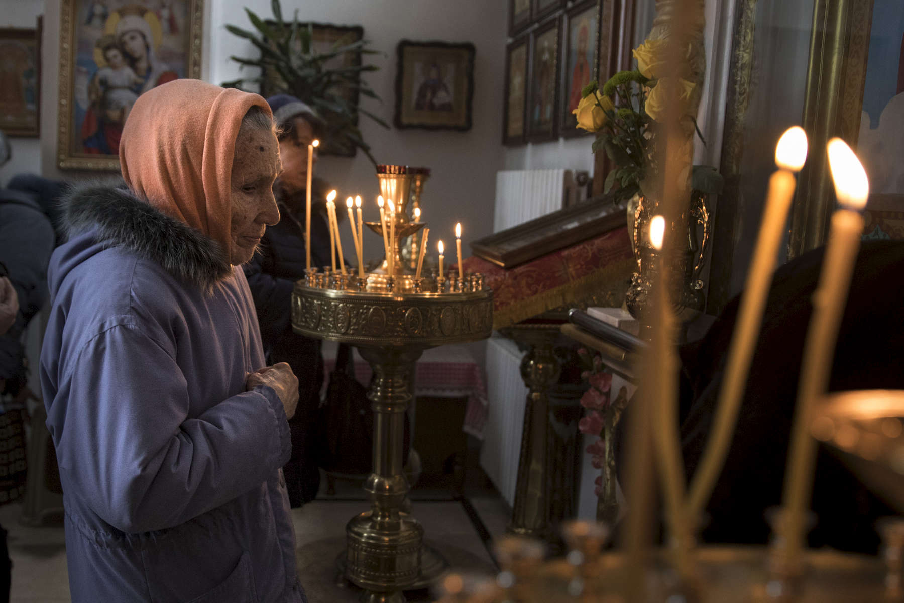 A woman lights candles during a Sunday service at a church in Donetsk.After more than four years of war the armed conflict in eastern Ukraine has a human toll that is staggering. The war has displaced more than 1.6 million with over 2,500 civilians killed and 9,000 injured. Some 200,000 people live under constant fear of shelling every day, with nearly a third of the 3.4 million people in need of humanitarian assistance over 60 years of age. Ukraine has the highest proportion of elderly affected by war in the world.