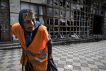 Donetsk People's Republic:Raisa Andreyevna, 72, walks by a local market area which was destroyed back in 2015. Since the start of the war she can no longer receive her Ukrainian pension of $50 a month so works as a janitor which pays her enough to survive. Originally from Russia, she now lives alone. Her children and grandchildren have all moved away to safer areas as part of Donetsk remain dangerous and occasionally gets shelled. {quote}I am not afraid to get killed because I have already lived my life but they have children they have to take care of.