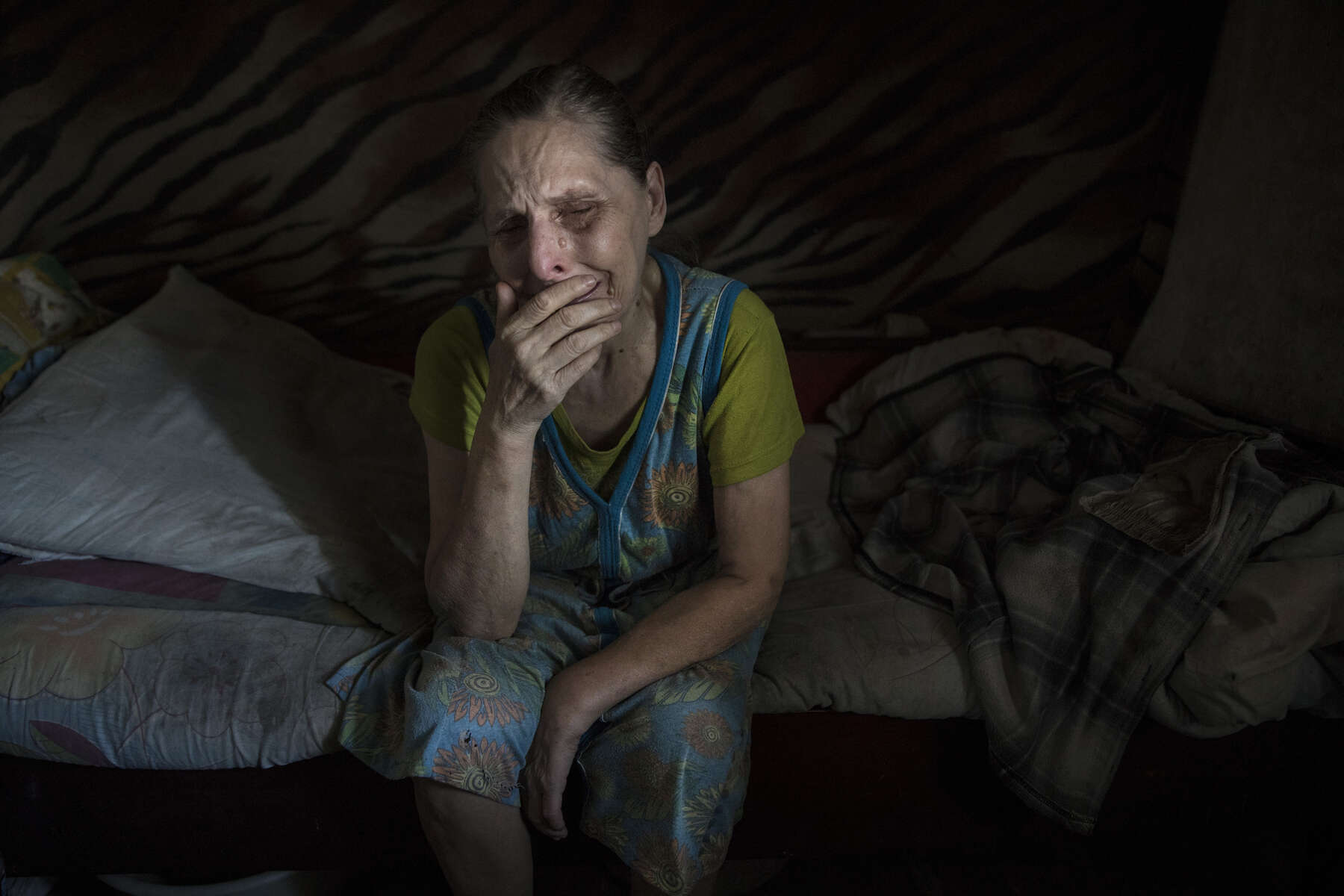 Avdiivika: Elena Parshyna,age 66, is blind and lives alone,feeling depressed and lonely after her husband had a heart attack in April. She says that she cries often now. Her son also died late in 2017 from the same fate. To make matter worse, Both were buried in a small cemetery that is mined and now too close to the military positions so she never can go visit the graves. The home was shelled last year, still damaged but Elena refuses to leave. Her remaining family - daughter and a sister all live on the other side of the contact line in Makeyevka city controlled by pro-Russian separatists.
