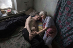 Opytne: Donetsk region: Raisa Petrovna, 80 and her husband Stanislav Vasilyevich reside in a village often caught in the crossfire between Ukrainian and Pro-Russian separatists. Opytne depends on humanitarian organizations to help the elderly who refuse to leave their homes and are trapped in a dangerous situation.Raisa says that they have learned to live with the sound of shelling and gunfire daily.  {quote}We were sitting at home, screaming at them not to kill us!{quote} Riasa said. {quote} Her husband was injured twice by shrapnel, once in his abdomen, requiring surgery. He suffers from a hernia that keeps on growing. Stanislav suffers from dementia now along with his other medical issues, he died from lack of proper medical care in September.