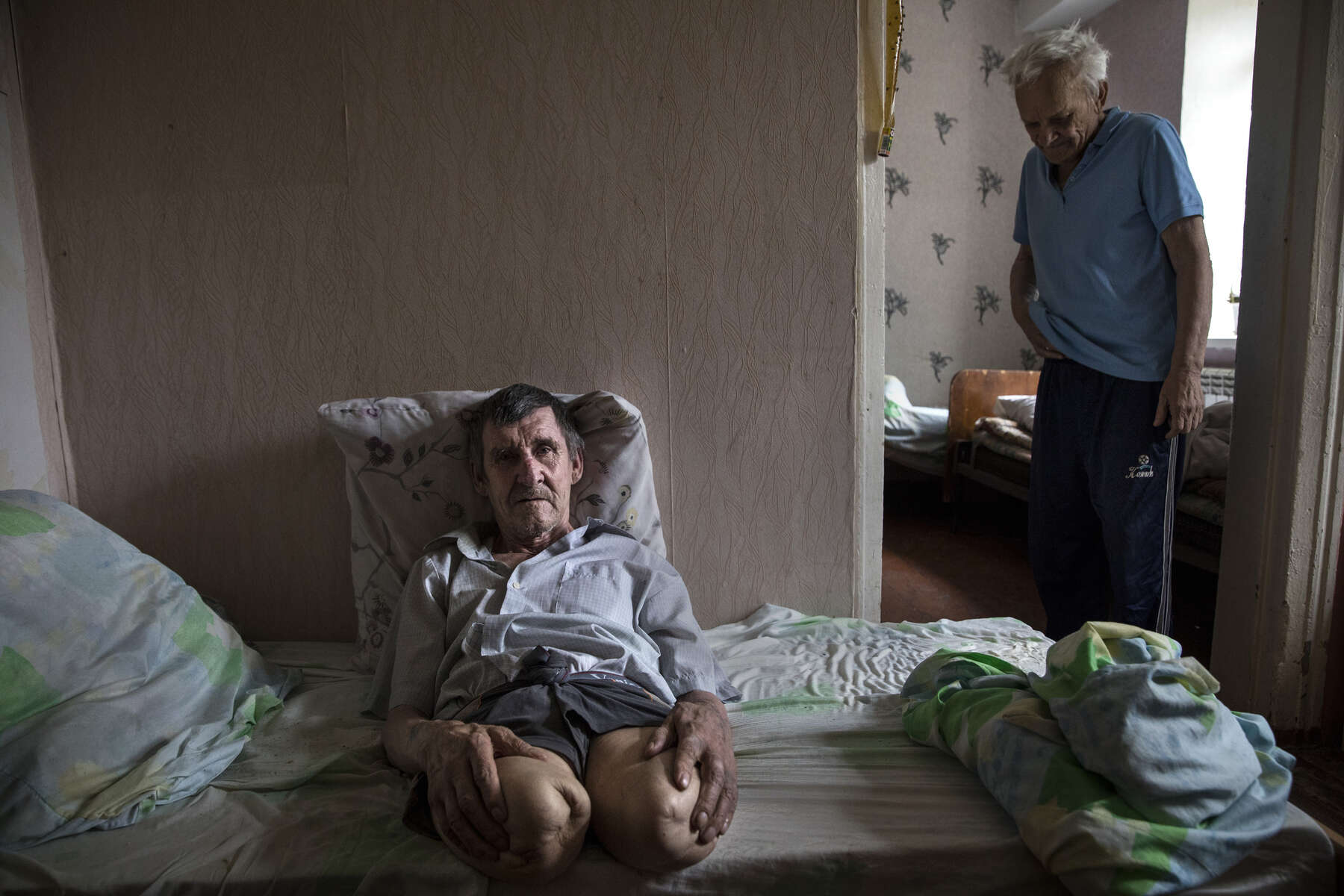 Ivan Ivanovich, age 65, is a double amputee but has no memory of how he lost his legs, he was brought to the Druzhkovka nursing home by healthcare workers. Ivan stated  {quote} No legs, No memory - I am not doing well.{quote}He was abandoned by his family, his daughter lives in Russia. He used to work as a coal miner. The nursing home facility takes care of many elderly who are left behind, and poverty stricken due to the war.