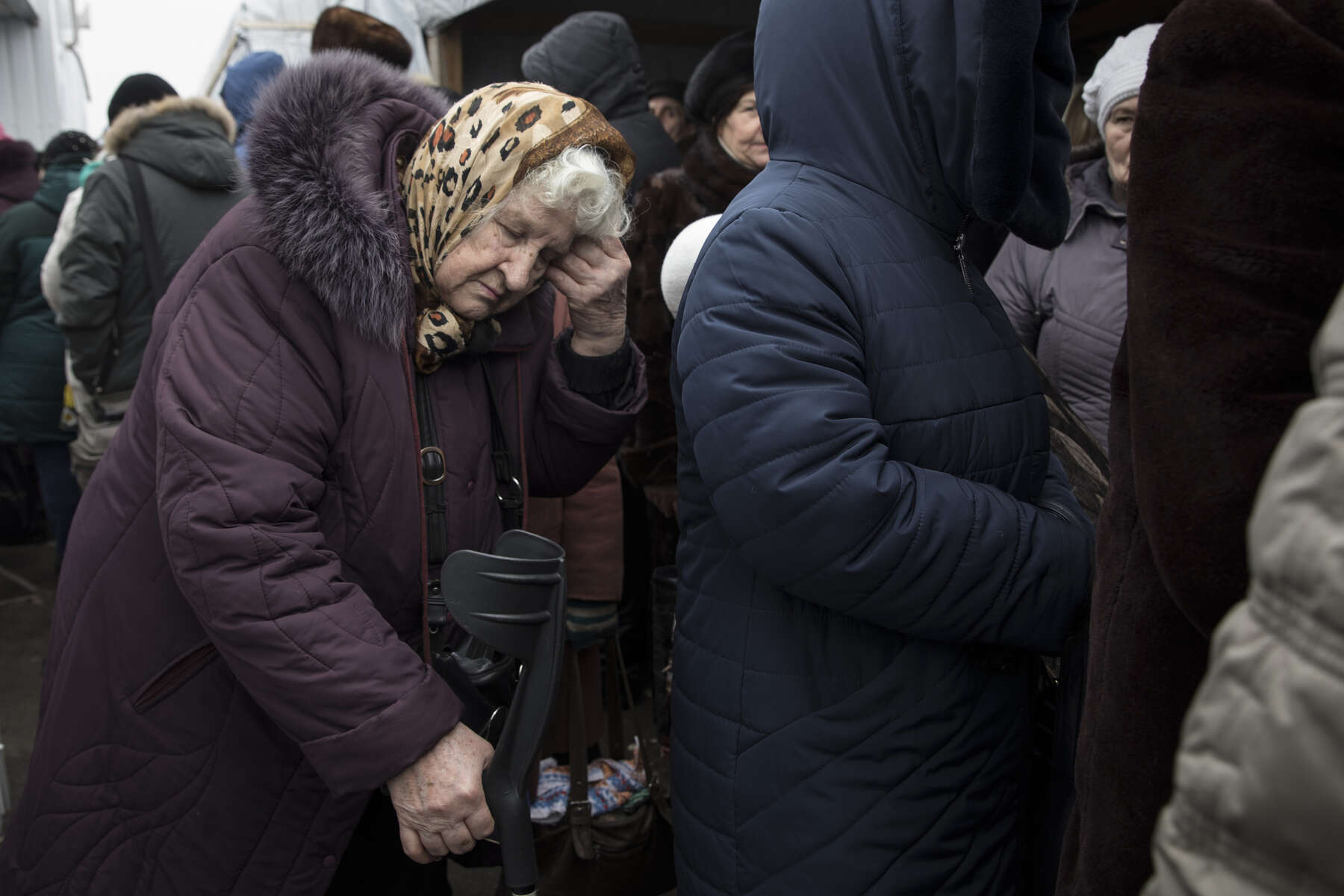 Mayorsk, Eastern Ukraine: An elderly woman is exhausted after waiting in line for hours in the cold to cross the border from Donetsk to the government-controlled territory of Ukraine in order to collect her pension.After more than four years of war the armed conflict in eastern Ukraine has a human toll that is staggering. The war has displaced more than 1.6 million with over 2,500 civilians killed and 9,000 injured. Some 200,000 people live under constant fear of shelling every day, with nearly a third of the 3.4 million people in need of humanitarian assistance over 60 years of age. Ukraine has the highest proportion of elderly affected by war in the world.