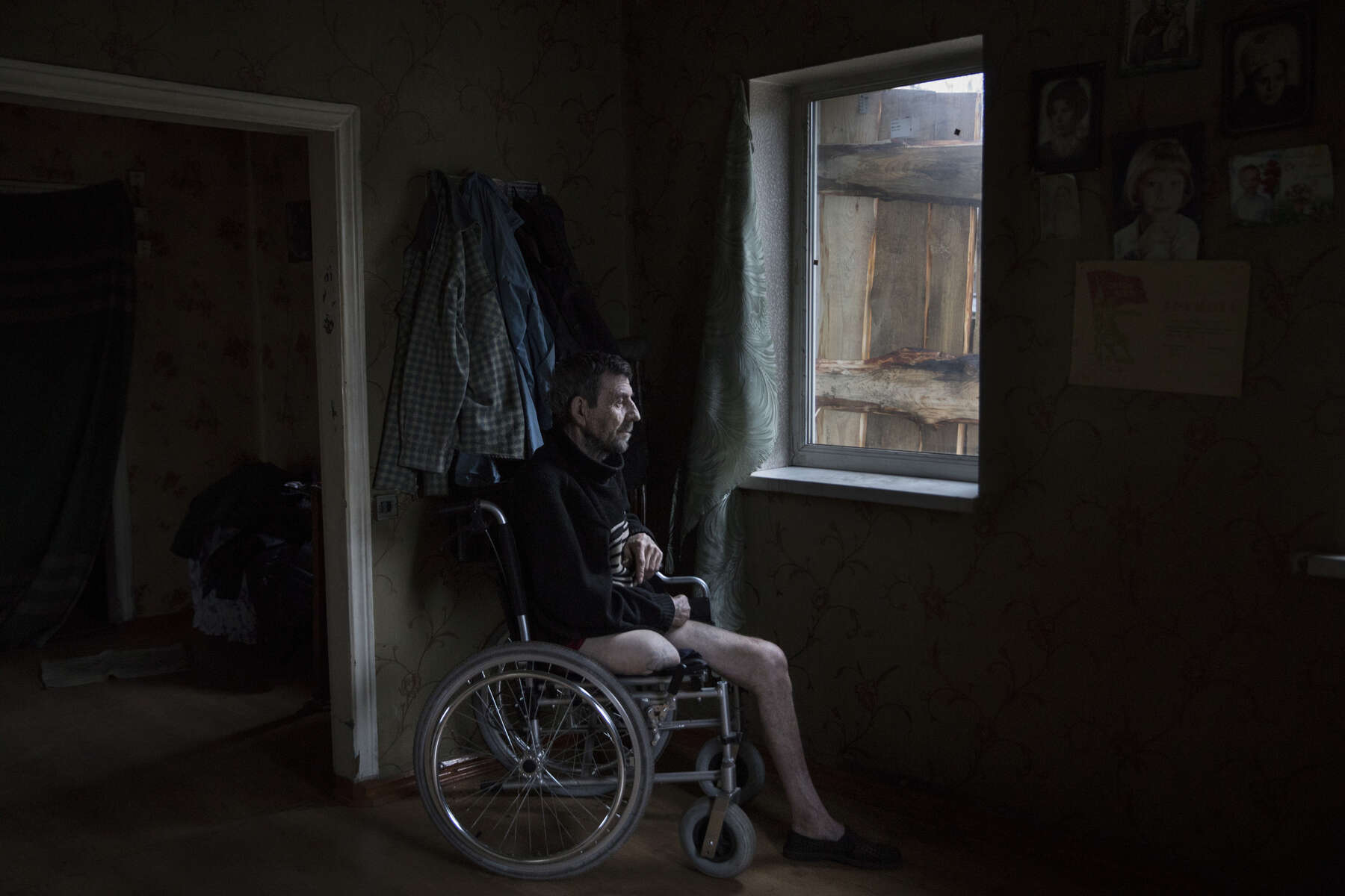 Avdiivka: Vladimir Mamoshyn, age 65, sits in his wheelchair, his wife died in 2010, now he lives alone his children abandoned him. He resides in the war-torn  Avdiivka village, less than a kilometer from the contact line where daily shelling and gunfire can be heard. In 2016, Vladimir lost his leg due to a vascular disease, with poor access to health facilities along with inadequate health care. After having a heart attack a few months later in 2017 he lost the use of his left hand, now he lives in a wheelchair depending on family and  friends to help him.