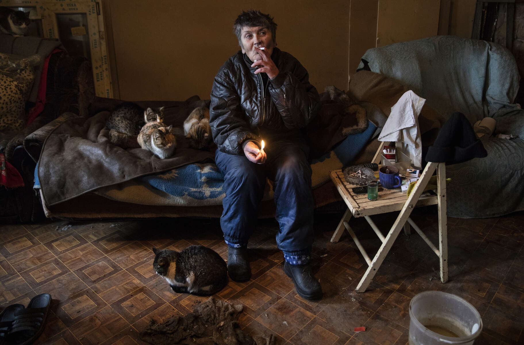 Avdiivika: Ludmyla Vasilevna, age 61, lives alone with her cats and a few dogs in a war torn village very close to the contact line where most have left due to the dangers. Her son is in the DPR military - militia. Her house was damaged over the years, refuses to leave as she has nowhere else to go.
