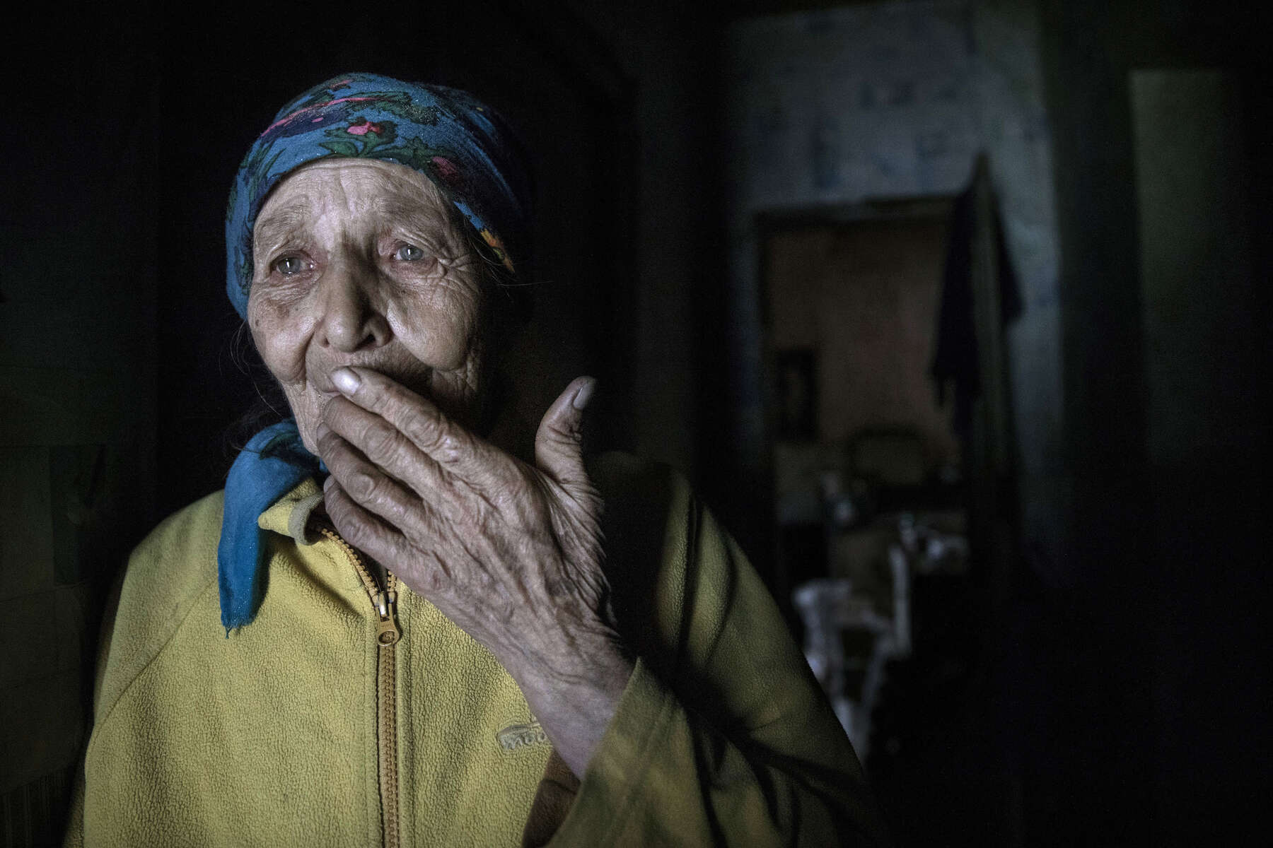 Opytne, Eastern Ukraine:  Mariya Gorpynych, age 76, lives alone. She speaks with tears in her eyes while talking about the death of her son and her husband. Her son Victor,48, was fatally injured by shelling near the home in 2016, he died in her arms. Then her husband, died in the same year from a heart attack caused by extreme stress. Mariya refuses to leave her village because her family are buried near by.{quote}I have nowhere to flee, my whole family is buried here.{quote}  {quote}I got used to the continued shelling.{quote} Opytne is a war torn village on the contact line where only 43 people are left due to the dangers.