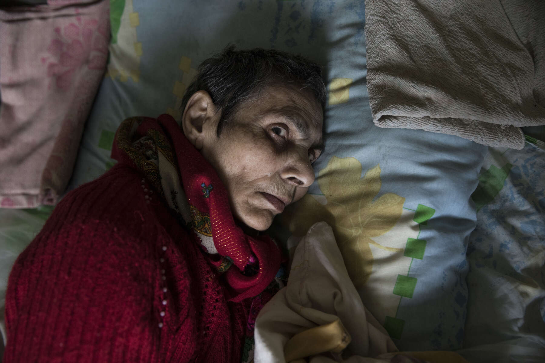Vera Cherepovskaya, age 65, rests at the Druzhkovka nursing home, has severe dementia, a social worker brought her to the home, she was abandoned by her family who fled the war-torn region. After more than four years of war the armed conflict in eastern Ukraine has a human toll that is staggering. The war has displaced more than 1.6 million with over 2,500 civilians killed and 9,000 injured. Some 200,000 people live under constant fear of shelling every day, with nearly a third of the 3.4 million people in need of humanitarian assistance over 60 years of age. Ukraine has the highest proportion of elderly affected by war in the world.