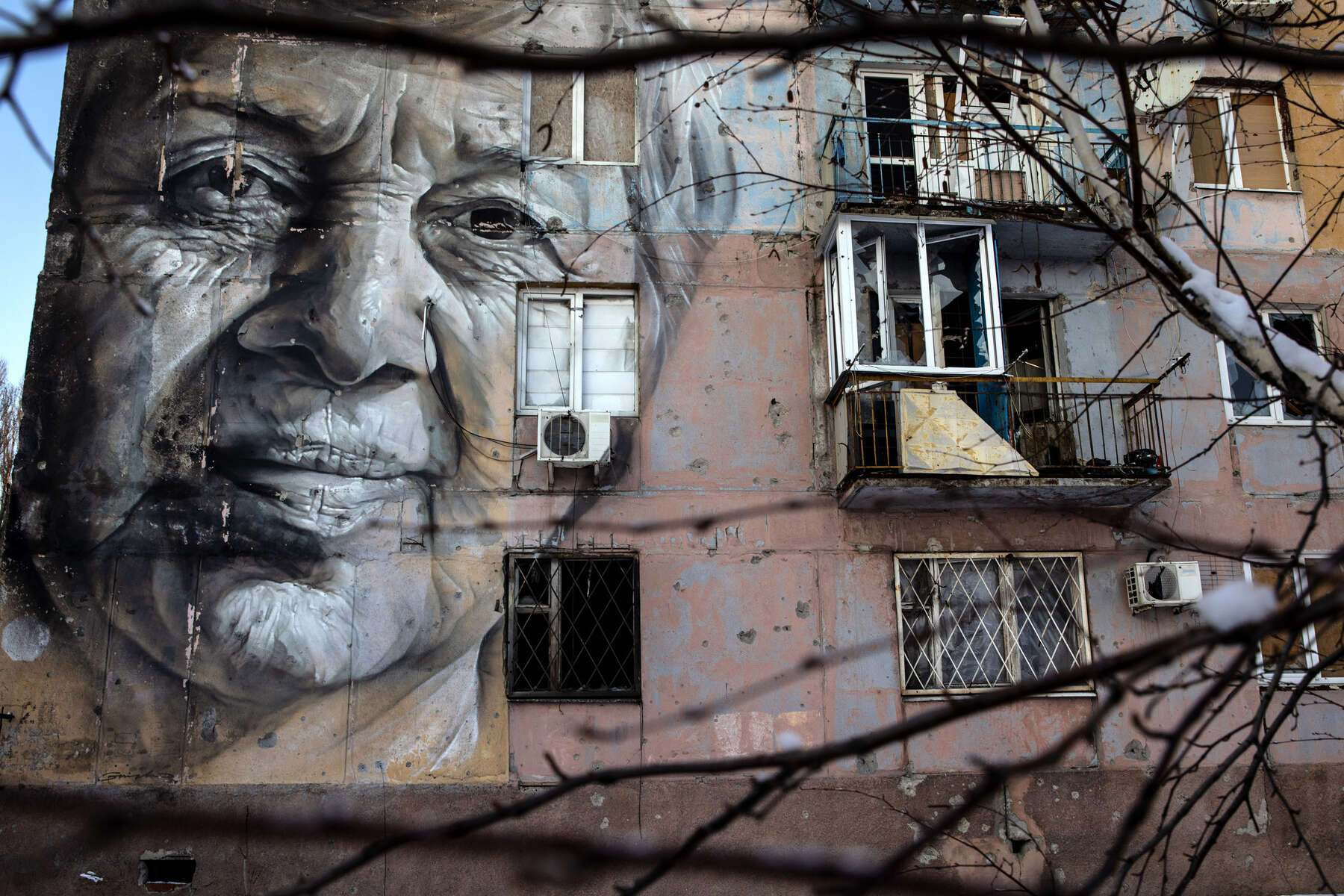 Avdiivka : A portrait of an elderly woman named Marina  Marchenko who was a teacher,  painted by an Australian artist  is seen on a war torn building, abandoned  in Avdiivka.After more than six years of war the armed conflict in eastern Ukraine has a human toll that is staggering. Some 200,000 people live under constant fear of shelling every day, with nearly a third of the 3.4 million people in need of humanitarian assistance over 60 years of age. Ukraine has the highest proportion of elderly affected by war in the world.BANGKOK - MARCH  :  in Taipei, Taiwan on March 19, 2020. According to CDC current totals the Coronavirus ( COVID-19) has now effected 235,939 globally, killing 9,874. It has spread to 157 countries. (Photo by Paula Bronstein/Getty Images )