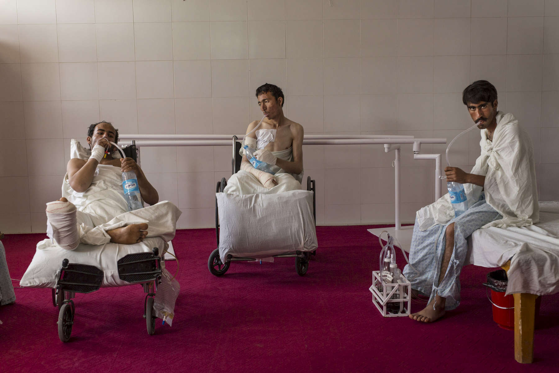LASHKAR GAH, AFGHANISTAN -MARCH 27, 2015: Patients that have chest injuries strengthen their lung capacity with water bottles in the physical therapy room at the Emergency hospital.  Afghan civilians are at greater risk today than at any time since Taliban rule. According to UN statistics, in the first half of 2016 at least 1,600 people had died, and more than 3,500 people were injured, a 4 per cent increase in overall civilian causalities compared to the same period last year. The upsurge in violence has had devastating consequences for civilians, with suicide bombings and targeted attacks by the Taliban and other insurgents causing 70 percent of all civilian casualties.