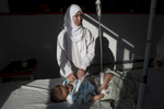 KABUL, AFGHANISTAN -MARCH 21, 2016:  Karima Mehrabi, a pediatric nurse cares for an infant in the women and children's ward at the Emergency hospital in Kabul on March 21, 2016. As of April, 2016 the Emergency hospital stated that in the first quarter their patient numbers were up more than 30% from last year. They stated that patients are coming from much further distances now especially since the bombing of the MSF hospital in Kunduz last year which cared for many in the region. Every year the UN comes out with their report documenting the unfortunate carnage from America's longest and most costly war in history. Along with the price tag estimated in the hundreds of billions, the human toll from a 2015 UN Assistance Mission To Afghanistan (UNAMA) report stated the number of Afghan civilians killed and wounded surpassed 11,000.  which was the deadliest on record for civilians in Afghanistan since the US-led invasion more than 14 years ago.