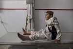 KABUL, AFGHANISTAN -MARCH 29, 2016:  At the Emergency hospital a Pashtun boy waits for an X-ray on his leg from a mine injury in Kabul on March 29, 2016. Every year the UN comes out with their report documenting the unfortunate carnage from America's longest and most costly war in history. Along with the price tag estimated in the hundreds of billions, the human toll from a 2015 UN Assistance Mission To Afghanistan (UNAMA) report stated the number of Afghan civilians killed and wounded surpassed 11,000.  which was the deadliest on record for civilians in Afghanistan since the US-led invasion more than 14 years ago.