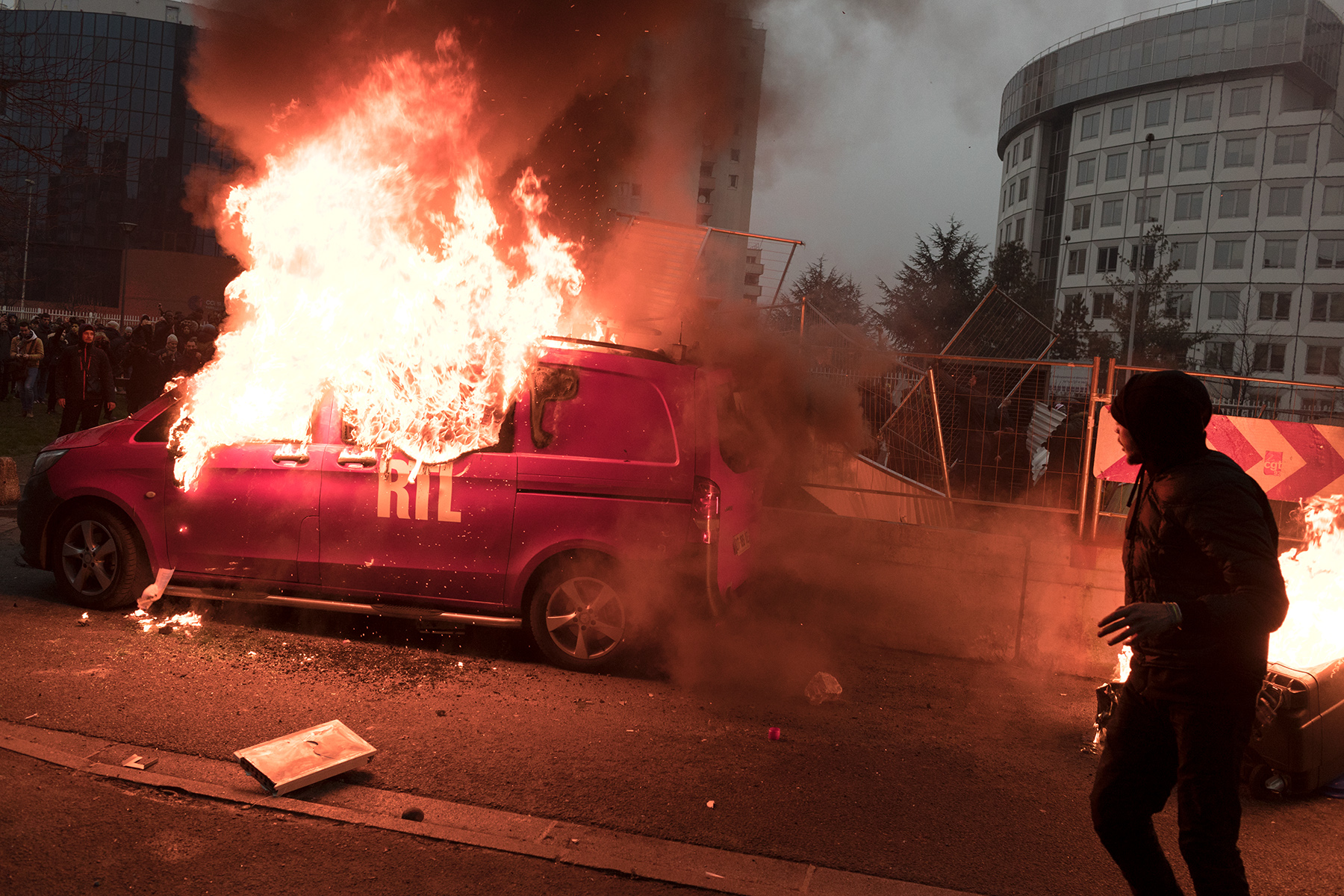 After a peaceful demonstration, other groups of youths clashed with the riot police and burned a RTL radio station van in Bobigny, France on Feb. 11, 2017.