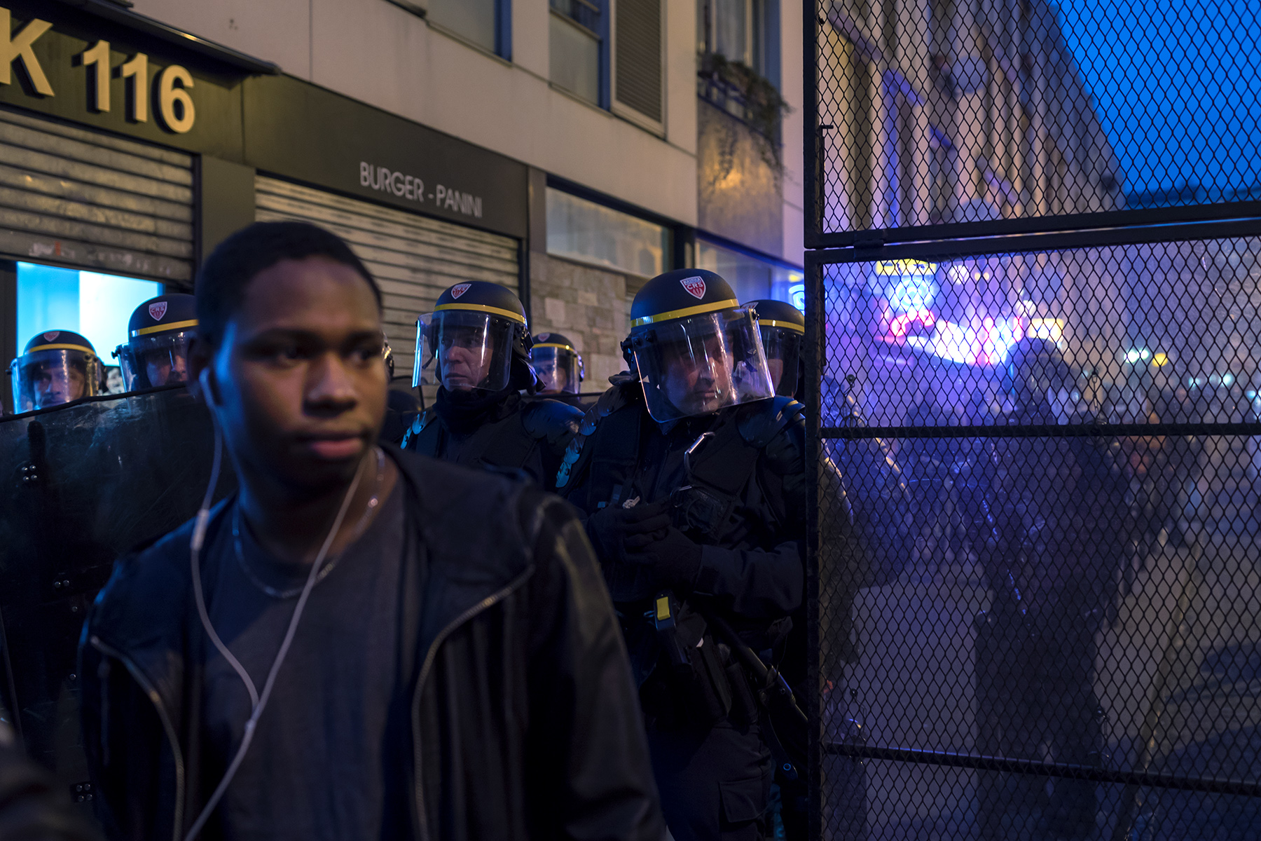 A young man stands in front of a police roadblock at Barbes station in Paris, France on Feb. 15, 2017.