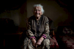 Roap, 90, watches with nostalgia for the Soviet Union, the Victory Day Military Parade in Moscow on her small tv in Bagaran (Shirak), an Armenian village on the Turkish border on May 9, 2018