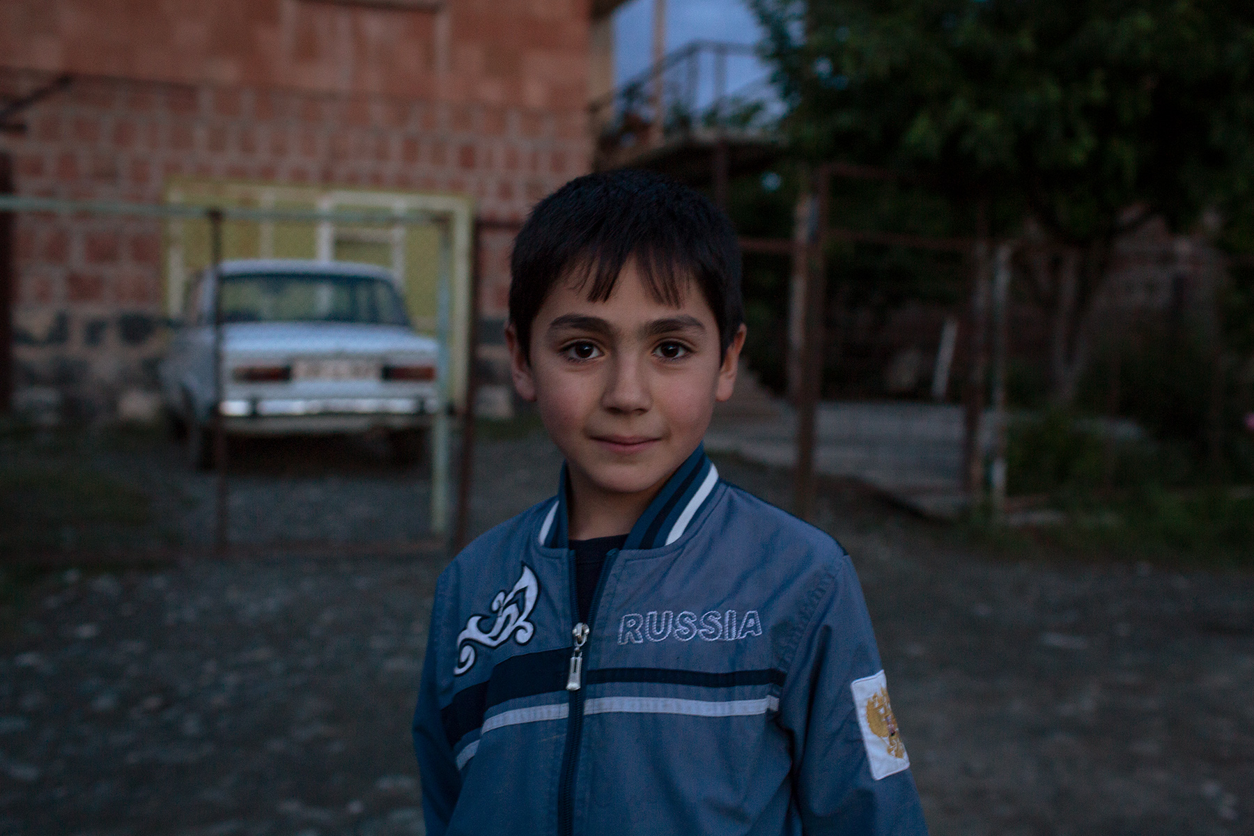 A boy plays in a street of Bagaran (Shirak), a small Armenian village on the Turkish border guarded by Russian soldiers.