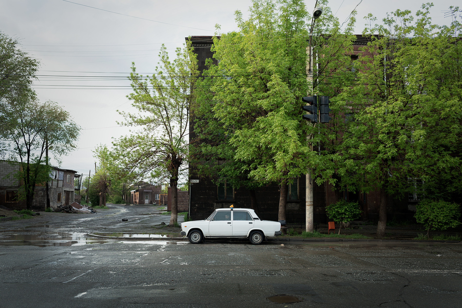 A taxi driver waits in a street of Gyumri (capital of Shirak) on May 2018. After the 1988 earthquake, unemployment exploded and since then the second largest city in Armenia has lost the half of its population.