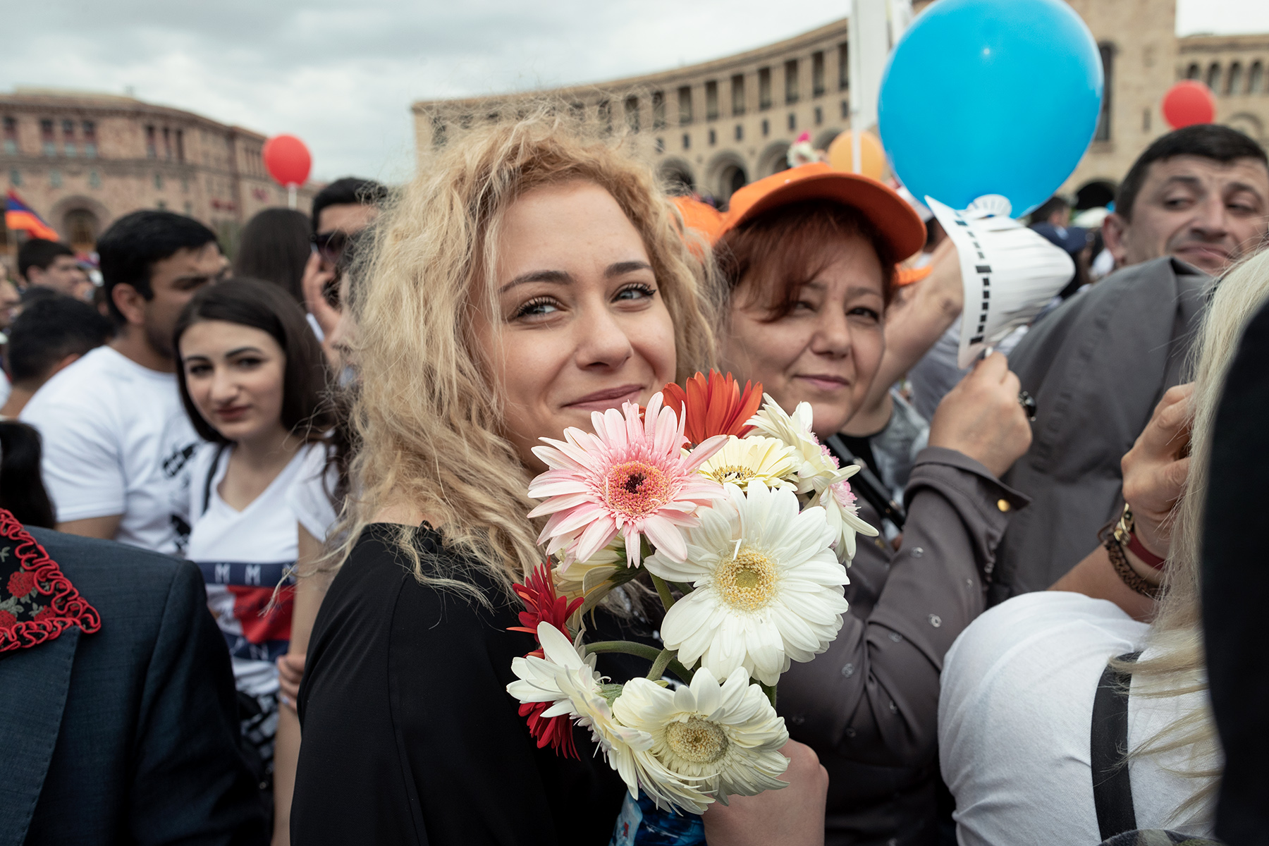 A young woman arrives on the Republic square with flowers to celebrate Nikol Pashinyan as new Prime minister after the parliamentary vote in Yerevan, Armenia on May 8, 2018