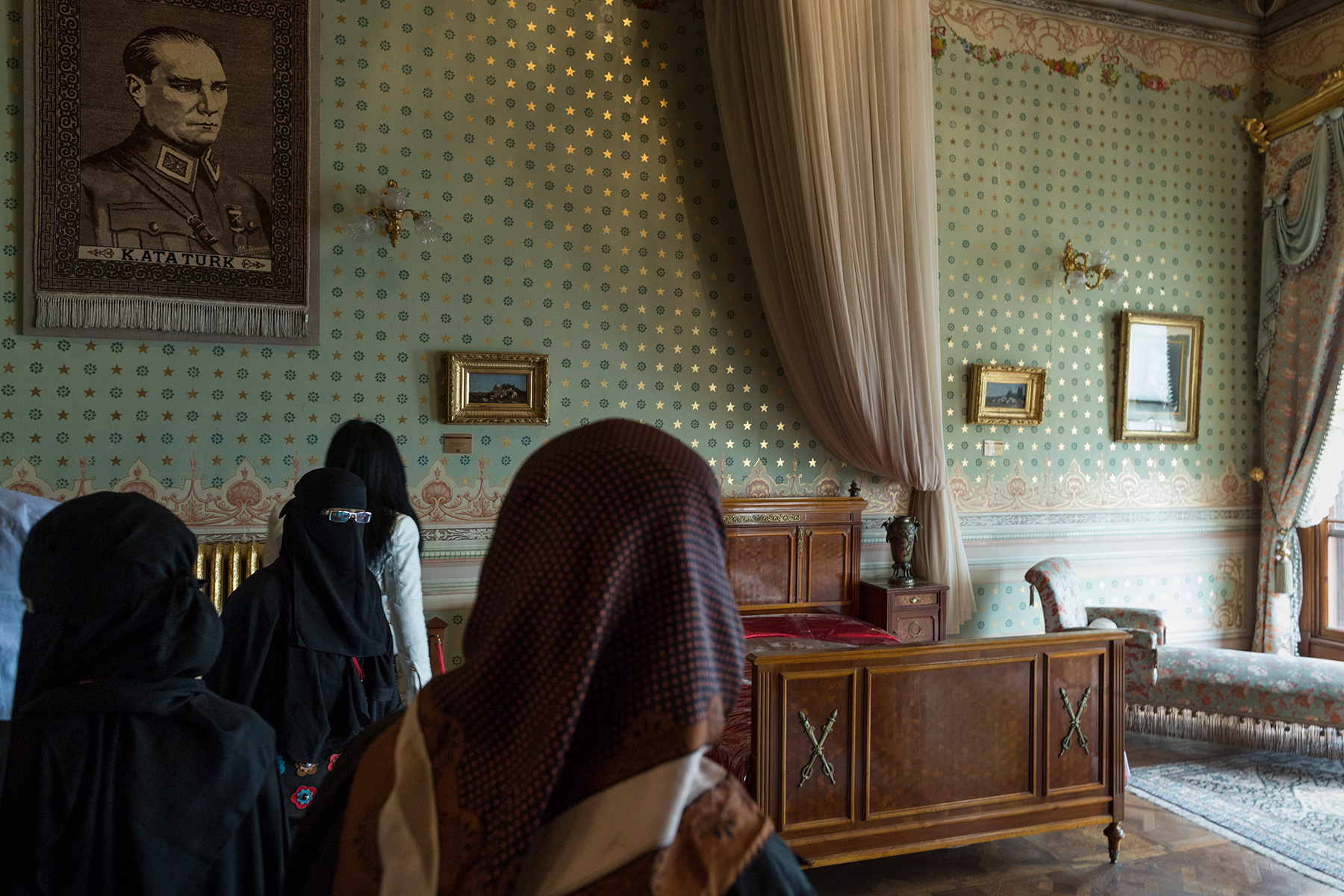 Turkey, 2017 - Women wearing niqab and hijab visit the death room of Atatürk.