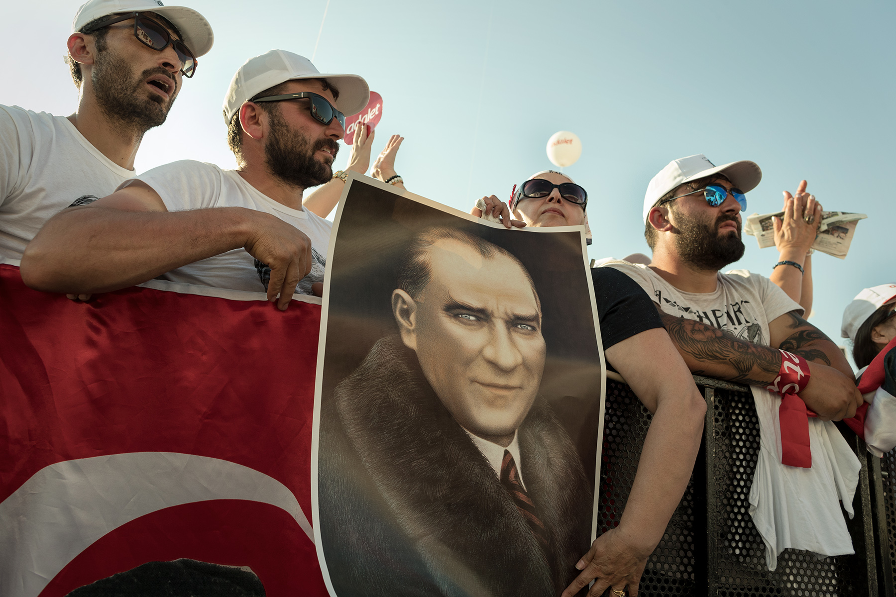 Supporters hold a portrait of Ataturk as Turkey's main opposition Republican People Party (CHP) leader Kemal Kilicdaroglu speaks at the 'Justice Rally' in Istanbul, Turkey, Sunday, July 9, 2017. The event concludes Kilicdaroglu's 25 days March from Ankara to Istanbul for accusing Erdogan of interference in court case of Enis Berberoglu, a CHP deputy who was sentenced to 25 years in jail for espionnage.