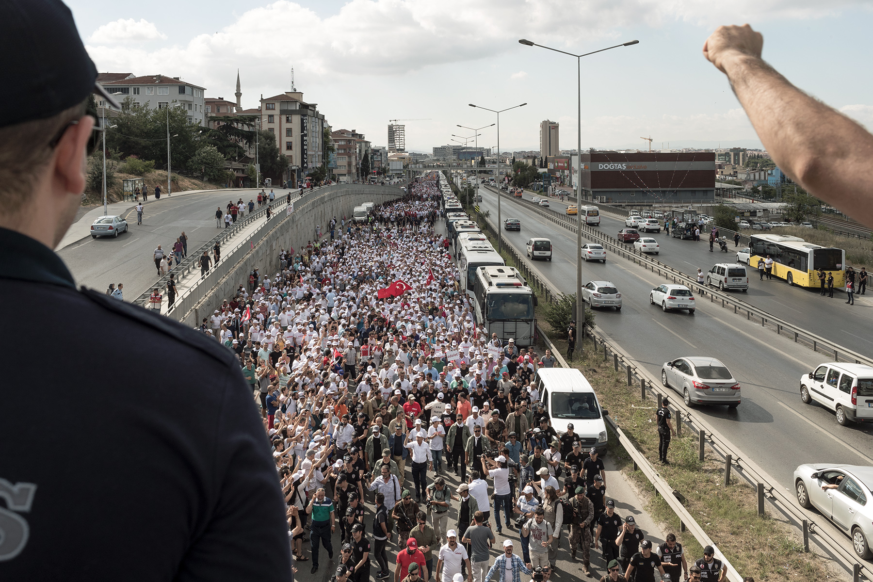 Tens of thousands supporters follow Turkey's main opposition Republican People Party (CHP) leader Kemal Kilicdaroglu as he arrives in Istanbul on day 24 after walking more than 400km from Ankara, Turkey, Saturday, July 8, 2017. Kilicdaroglu accuses President Erdogan of interference in court case of Enis Berberoglu, a CHP deputy who was sentenced to 25 years in jail for espionnage.
