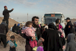 Iraqis displaced from Mosul get into military trucks and buses to be transferred to various camps. Bartella, Mosul, Iraq on Jan. 7, 2017.