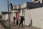 Technicians connect housings to the main generator in Mosul, Iraq on Jan. 6, 2017. In Samah neighborhood, life returns to normal after ISIS left.