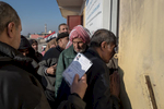 Sick and injured people gather to the door of the the Medical Advanced Post of Gogjali in Mosul, Iraq on Jan. 7, 2017. This station and the emergency post of Medecins du Monde on the side are the only medical posts from Mosul to the Khazir displaced center, 40 km away.