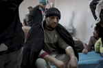 A man with a lost look in his eyes is treated in the Medical Advanced Post of Gogjal, Mosul, Iraq on Jan. 7, 2017.