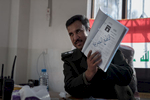 Lieutenant Colonel Yassin Ahmad Abbas, chief of Hammam al-Alil police, seriously injured during an ISIS attack, shows in his office a list with several ISIS members. Hammam al-Alil, Iraq on Jan. 9, 2017. According to him, time of vengeance will come.